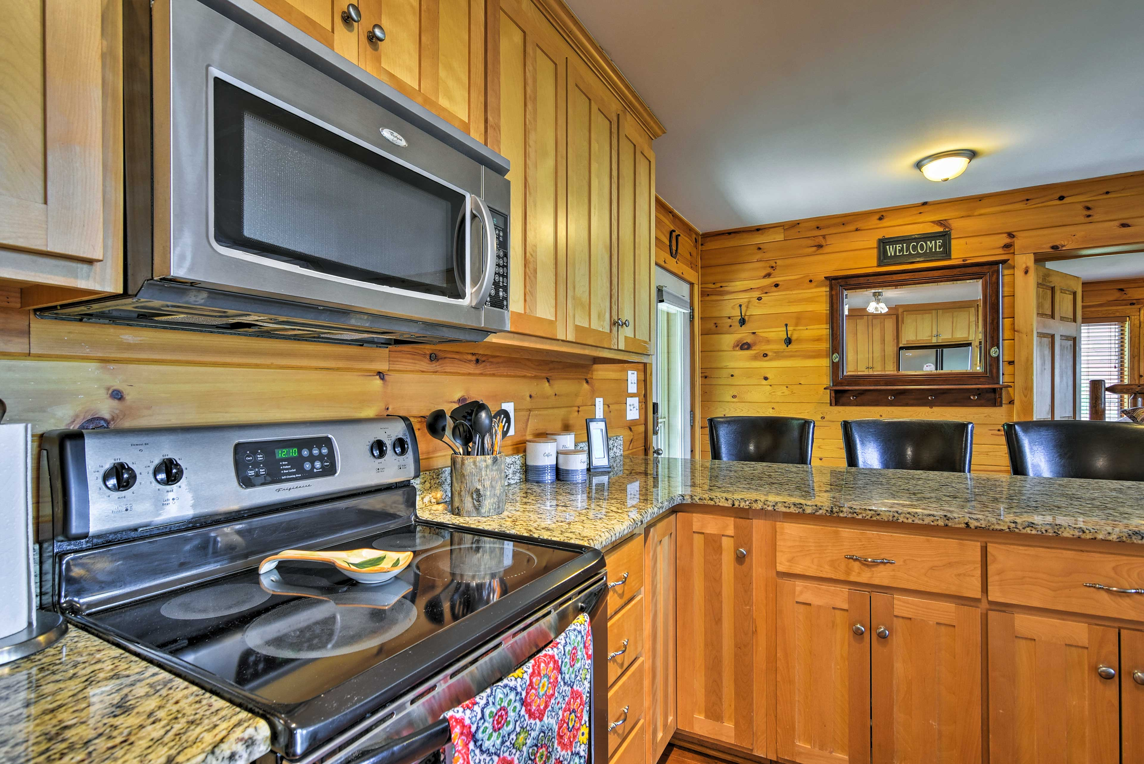 The kitchen is fully equipped with sleek appliances & granite countertops.