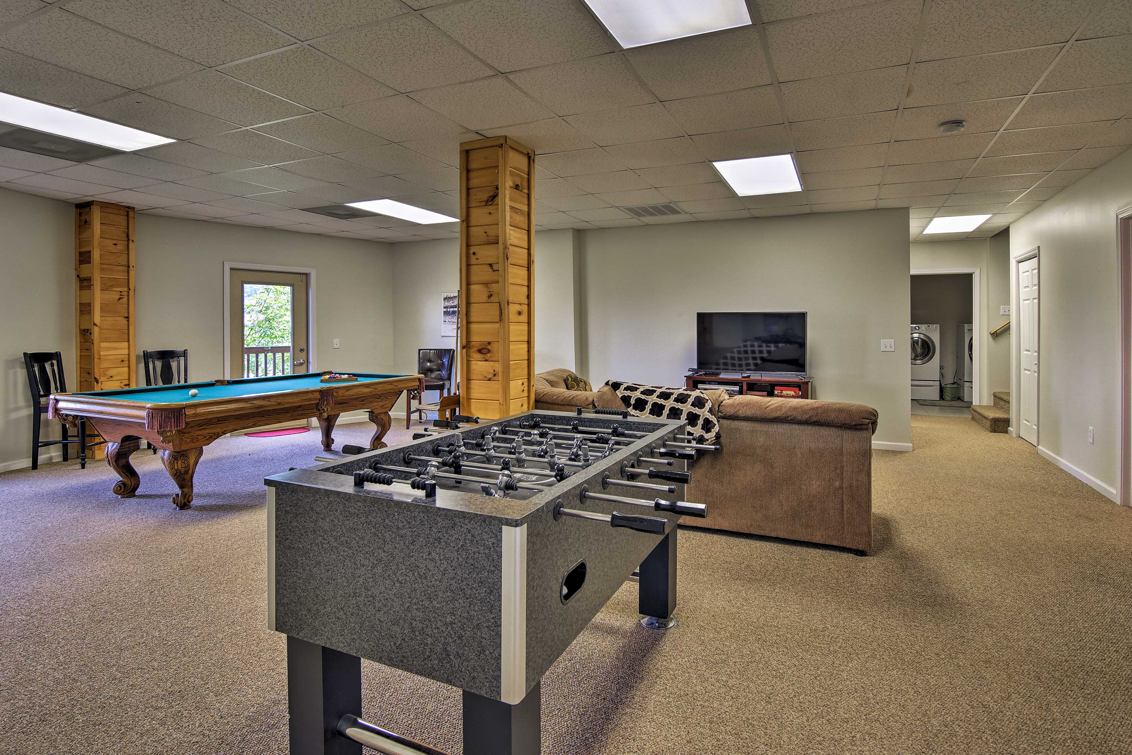 Watch your favorite sports team on the 52-inch flat-screen TV.