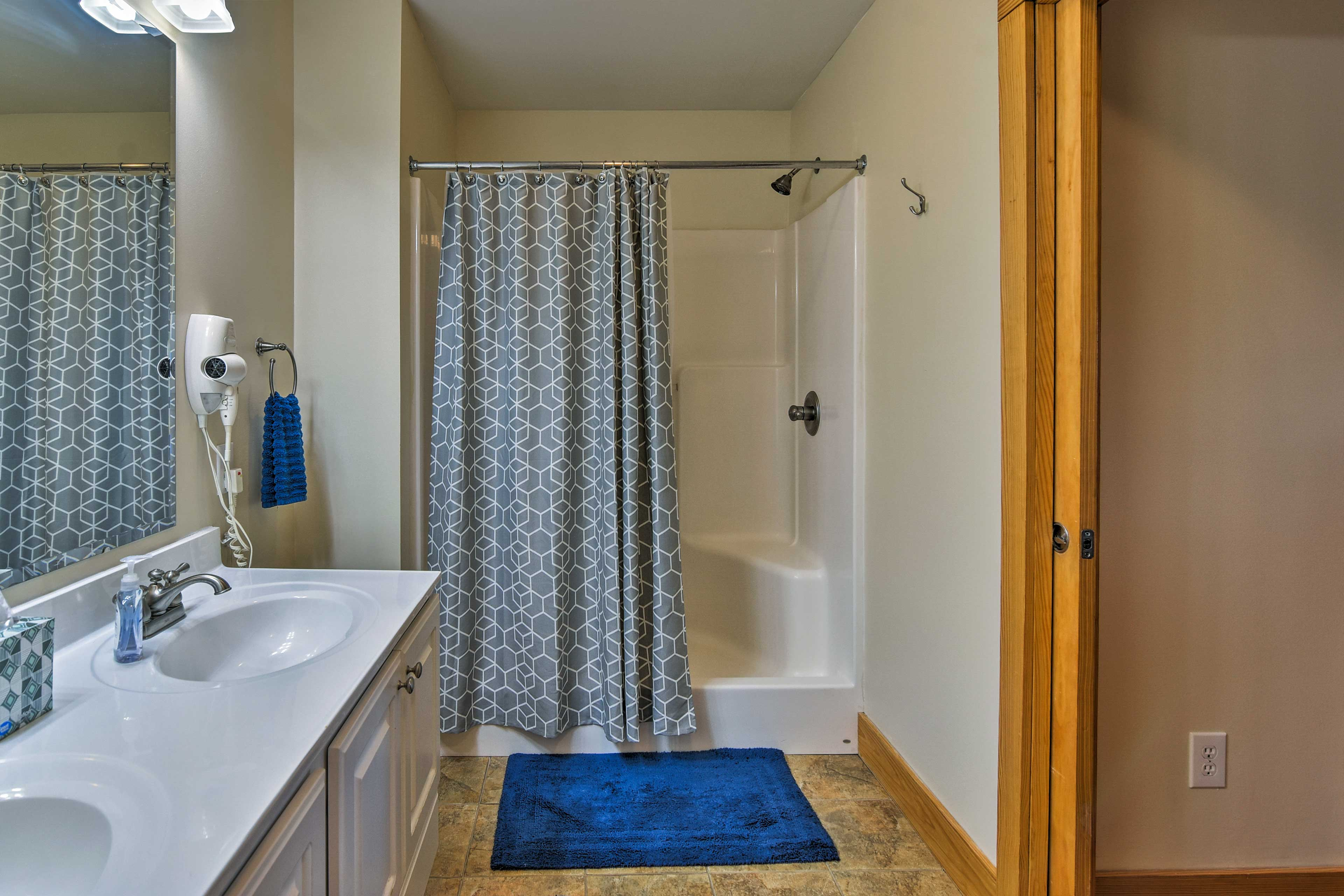 Wash up in the master en-suite, equipped with a shower/tub combo.