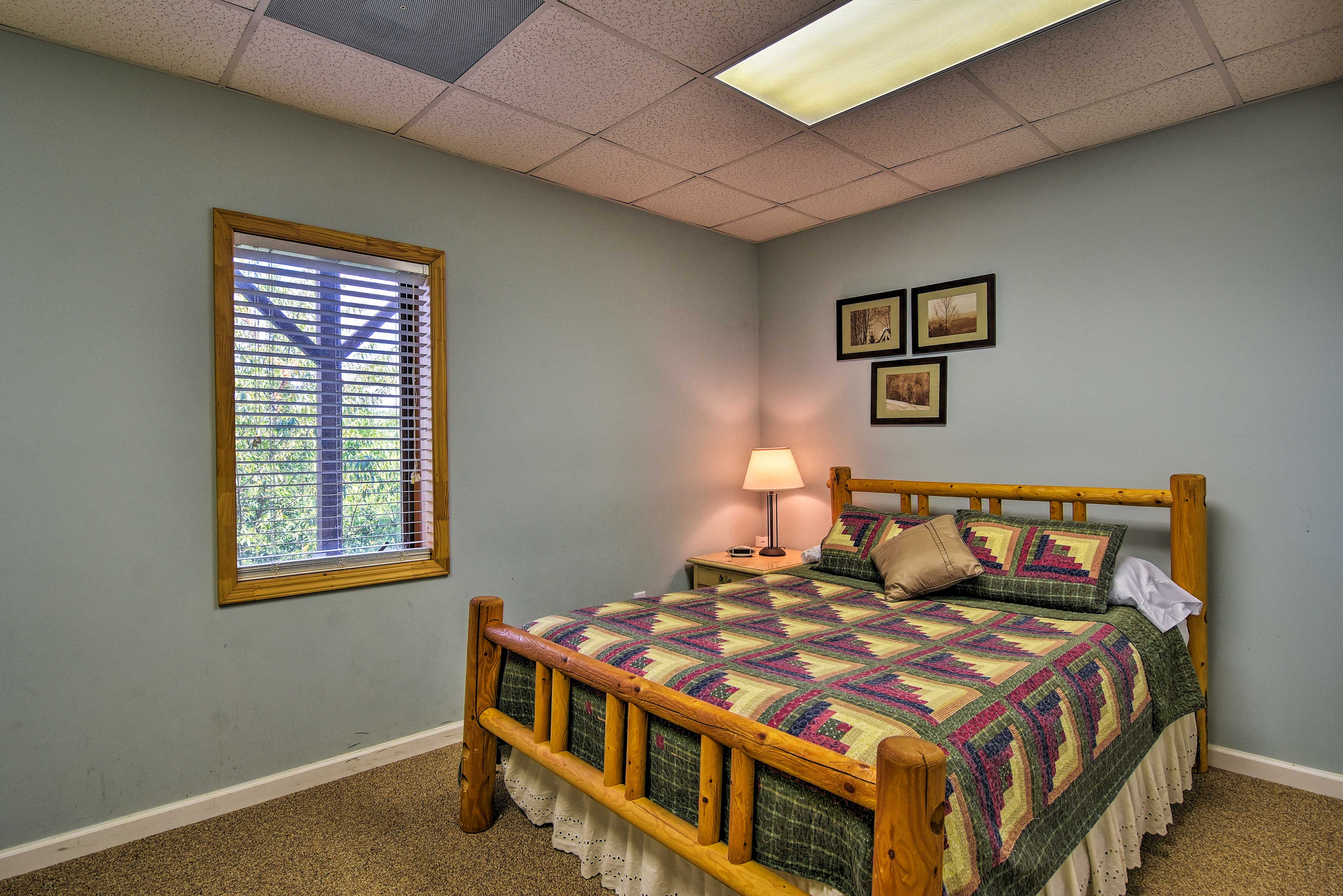 Friends can snag a spot on the queen bed in the third bedroom found downstairs.