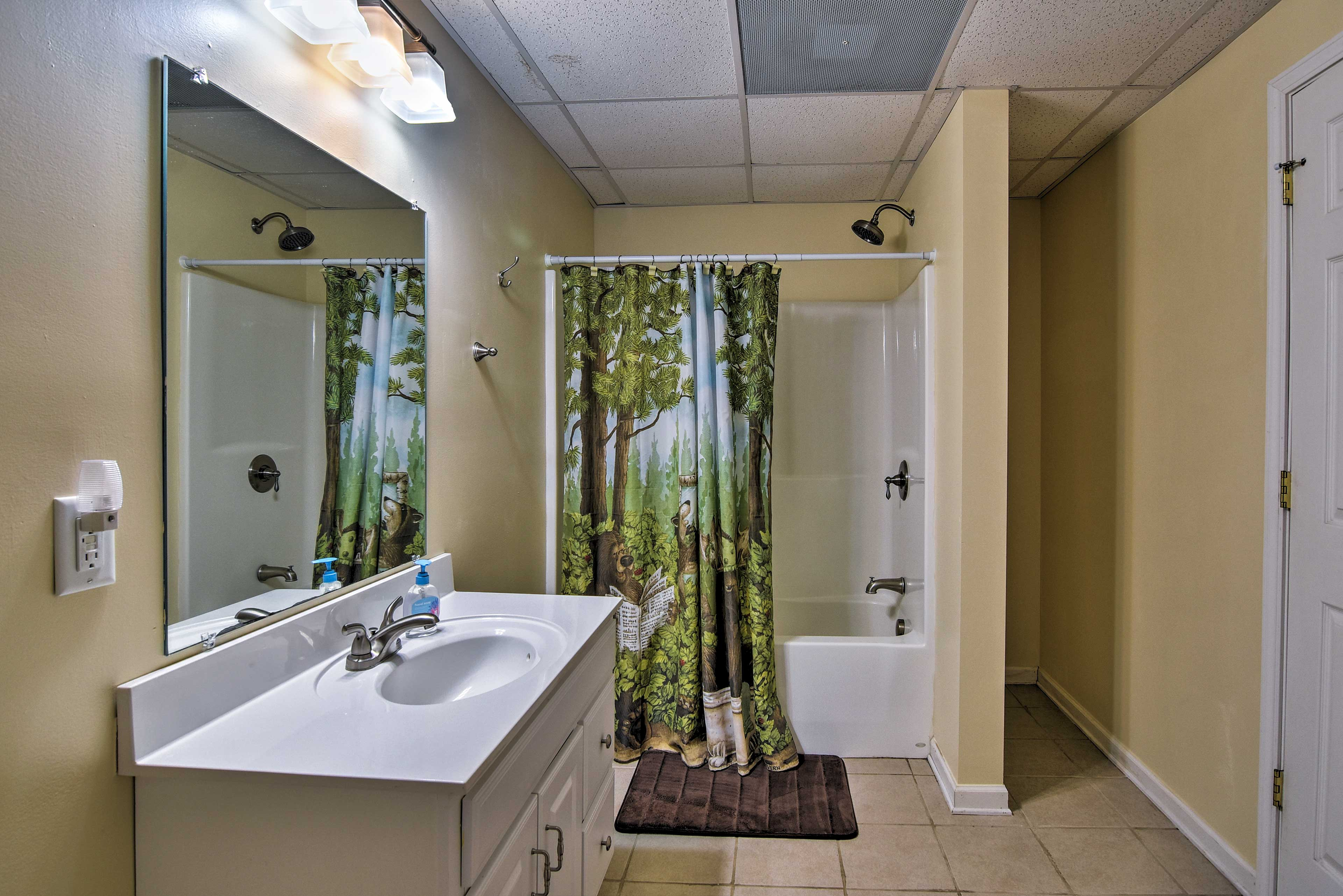Clean off the mountain dirt in the shower/tub combo in the third bathroom.