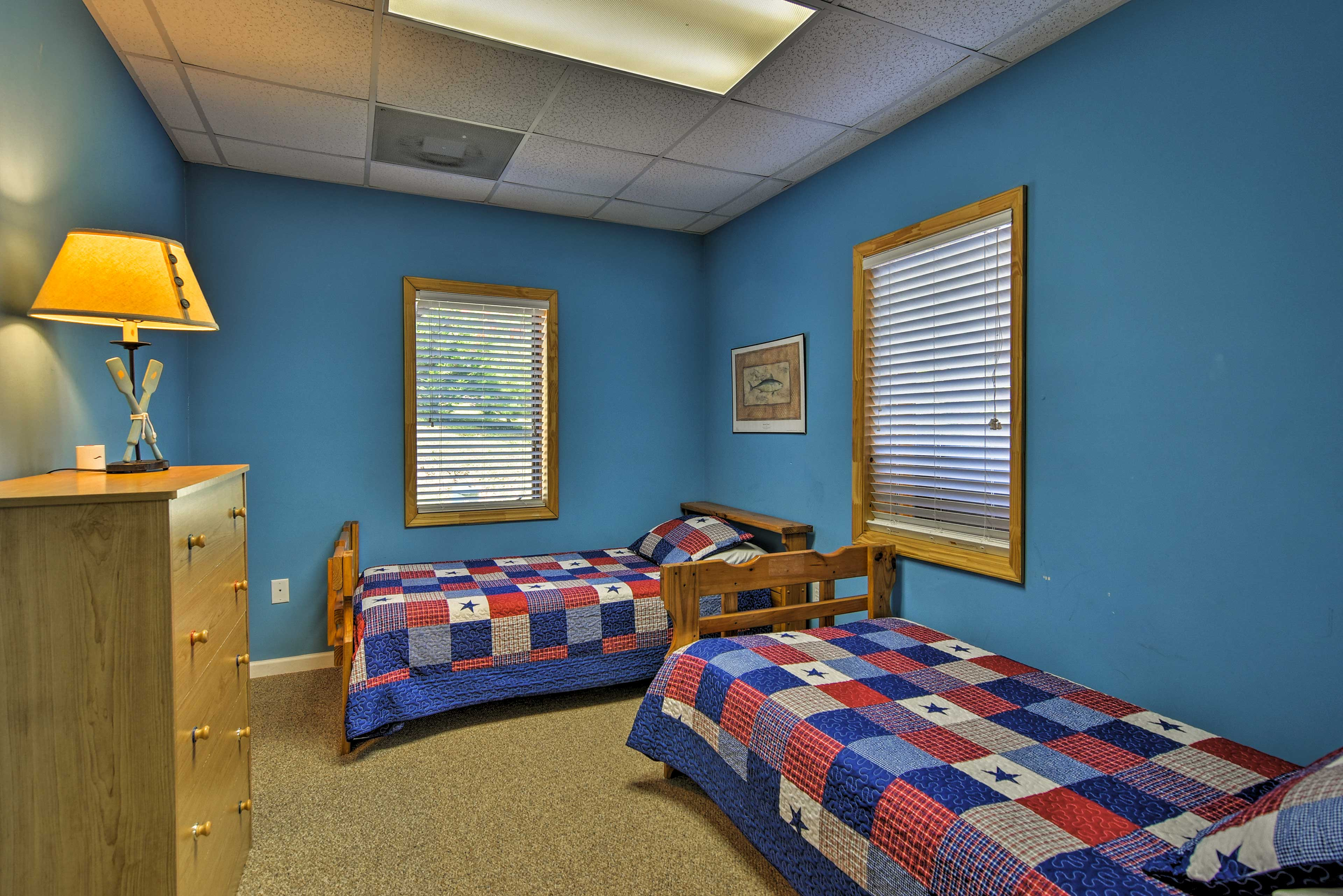 Tuck the kids into the twin-over-twin bunk bed in this room.