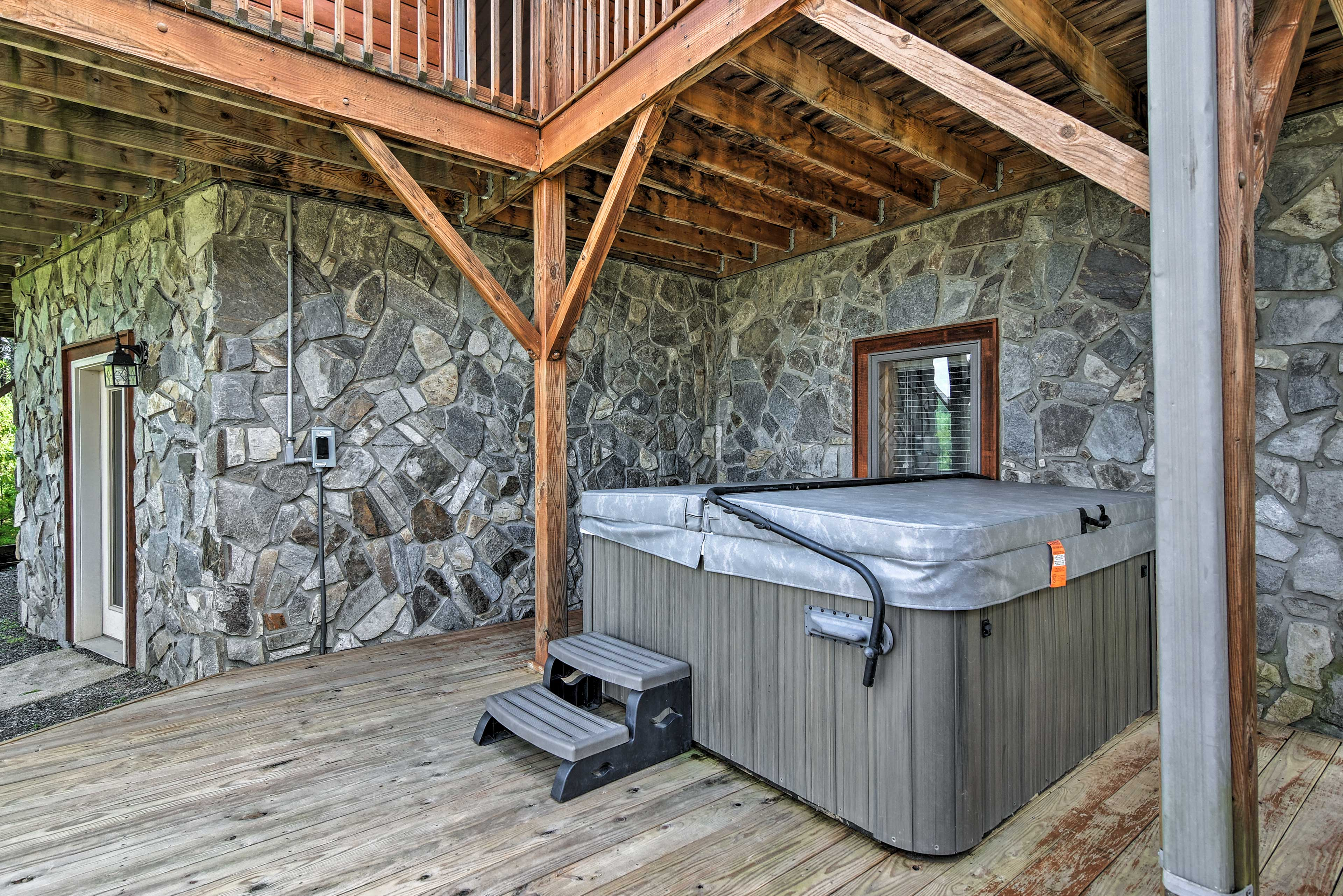 Ease sore muscles in the lavish private hot tub!