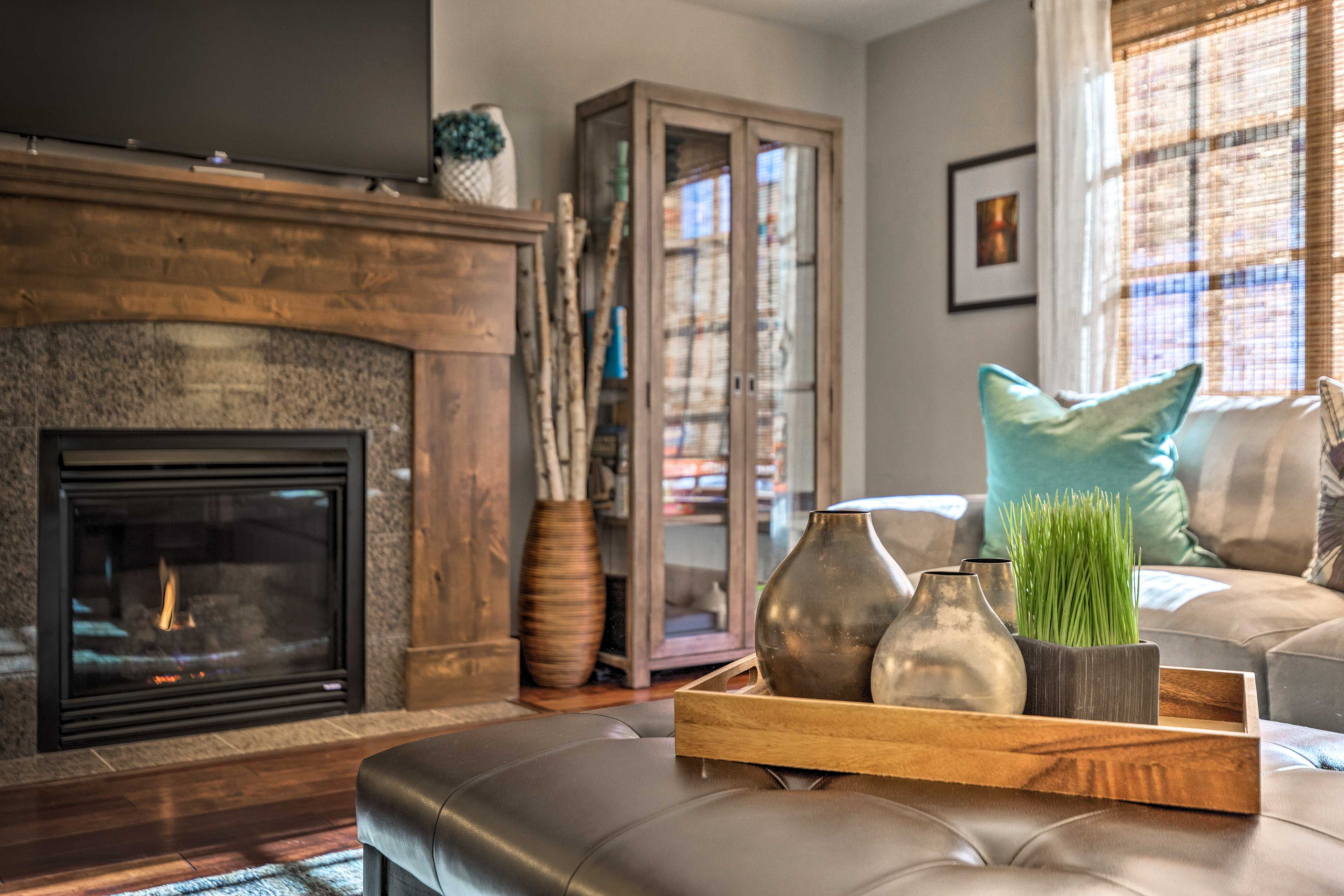 Prop your feet up in front of the gas fireplace while watching the cable TV.