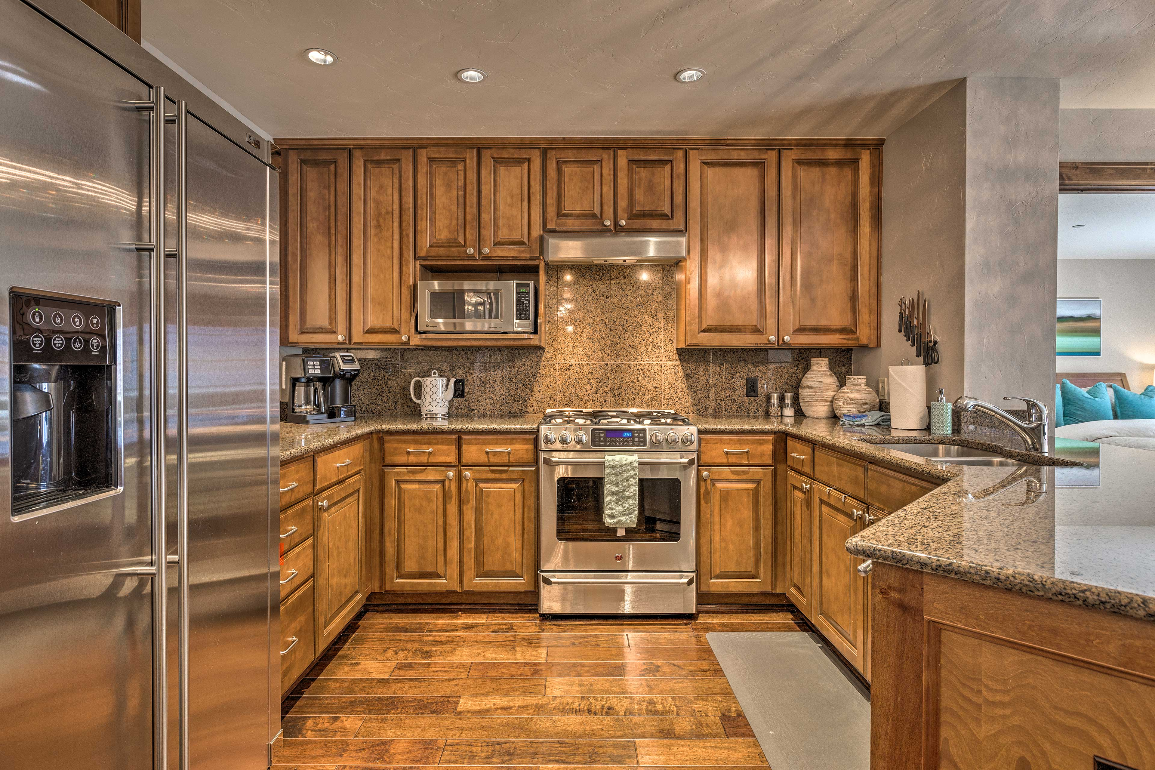 The fully equipped kitchen with stainless steel appliances makes cooking a joy.