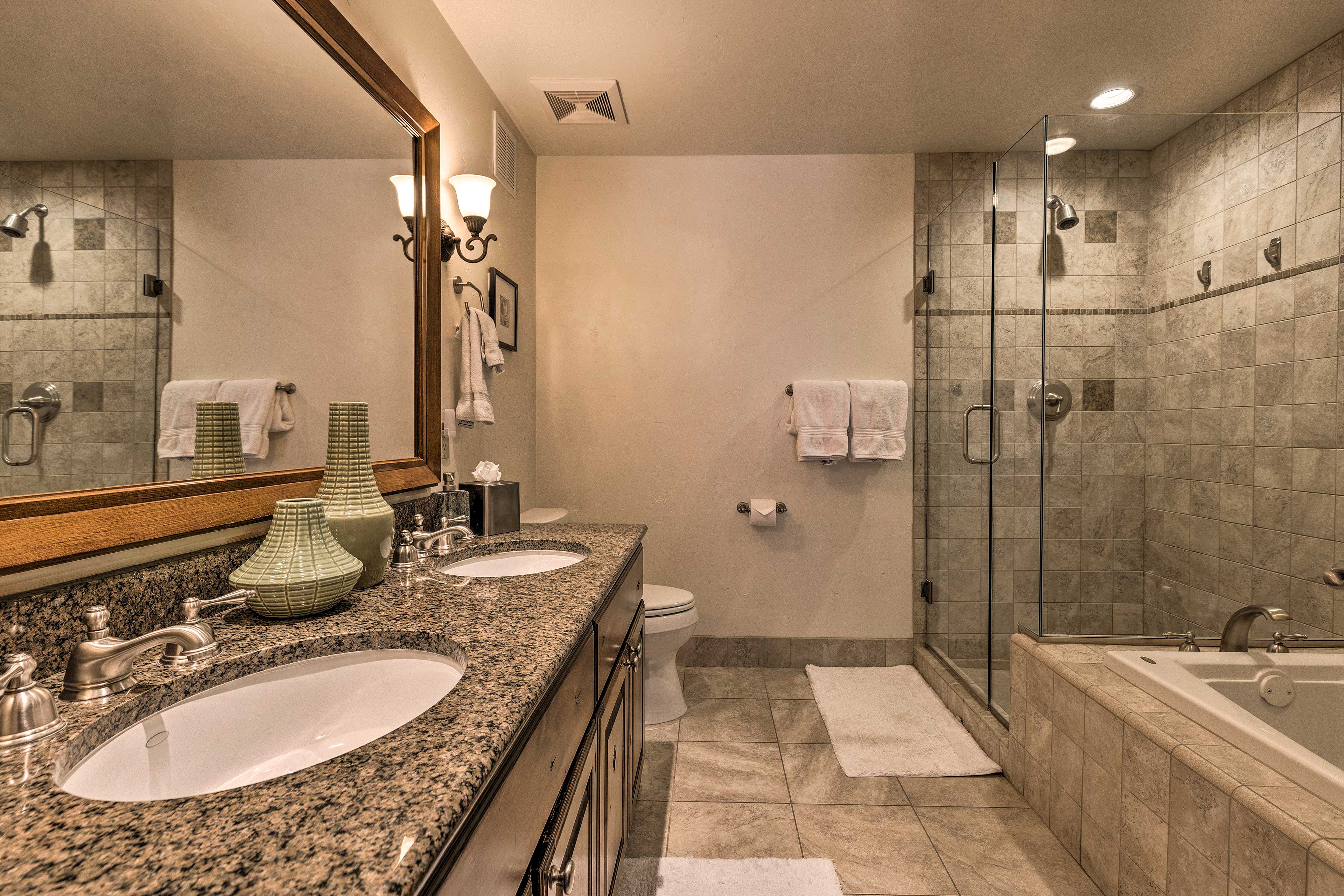 His-and-her sinks provide ample counter space for couples.