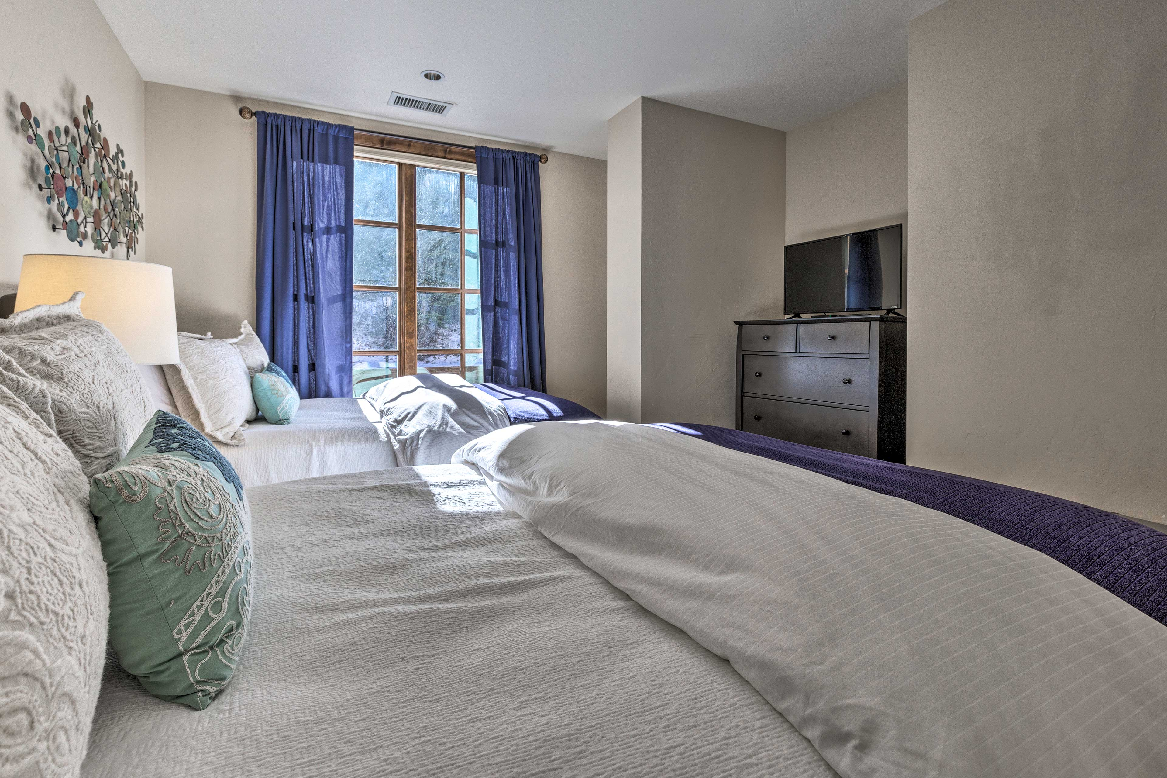 Fall asleep to your favorite movies on the flat-screen TV.