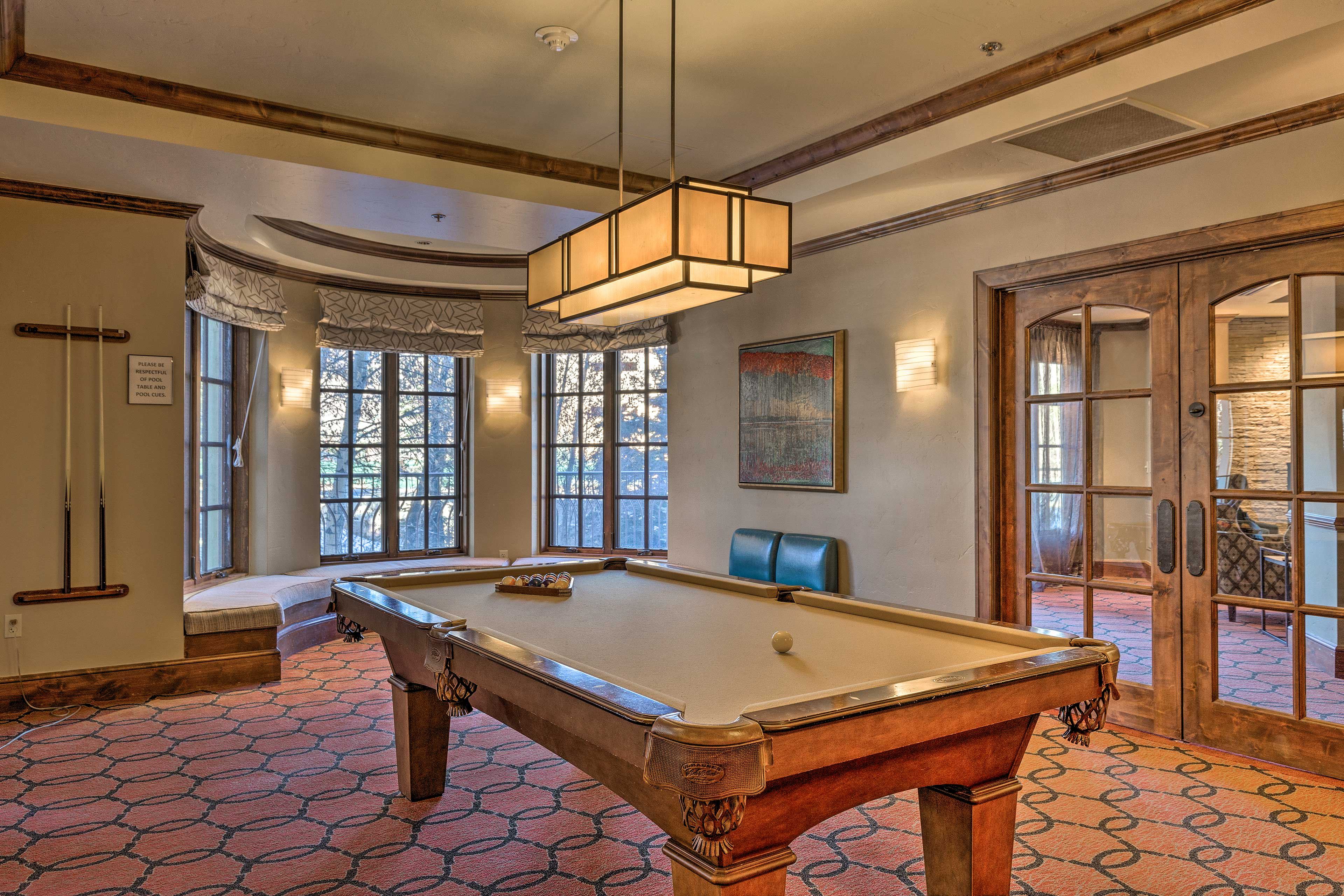 Challenge your fellow travelers to a competitive game of pool!