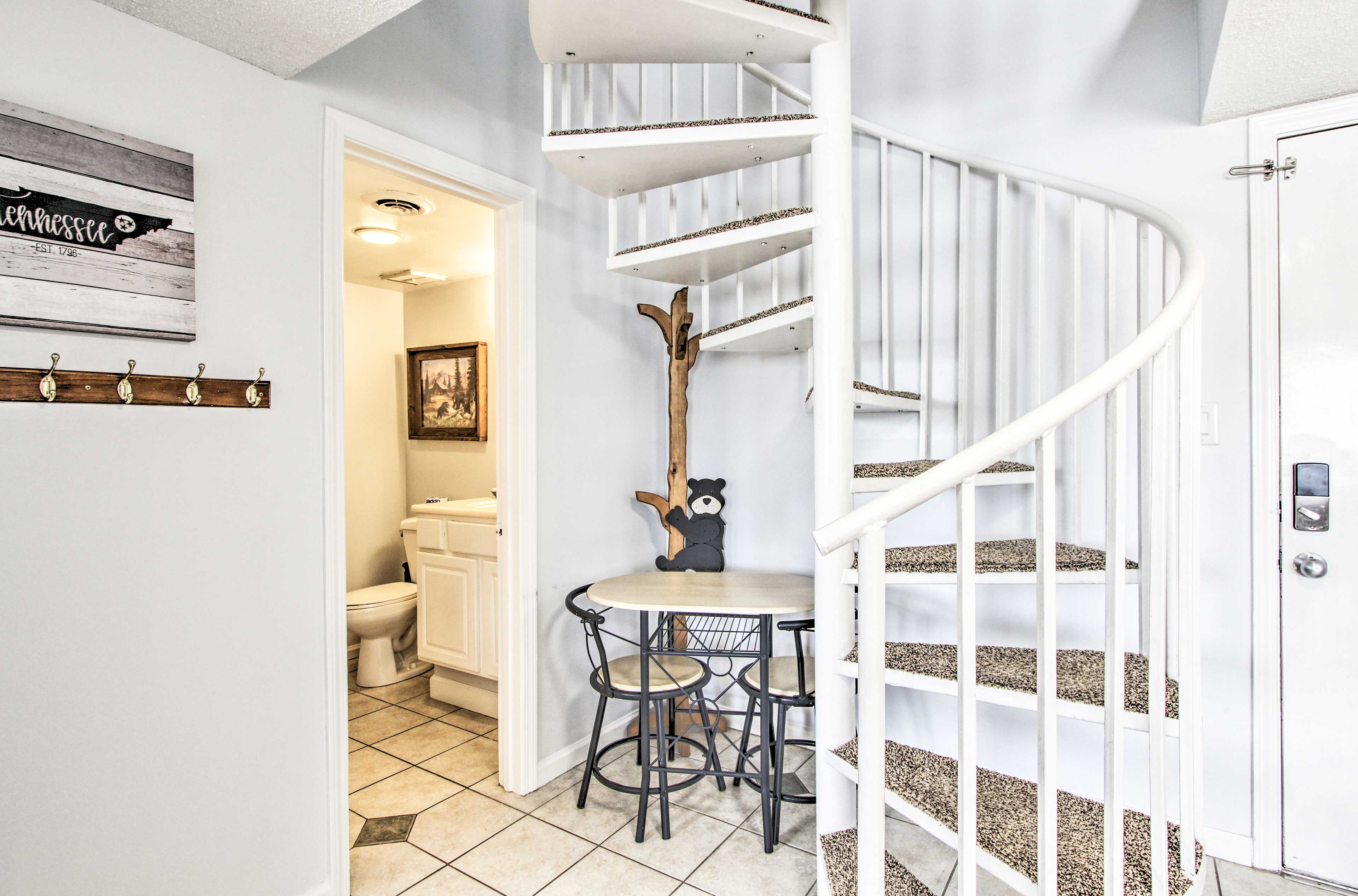 Climb up the spiral staircase to explore the loft.