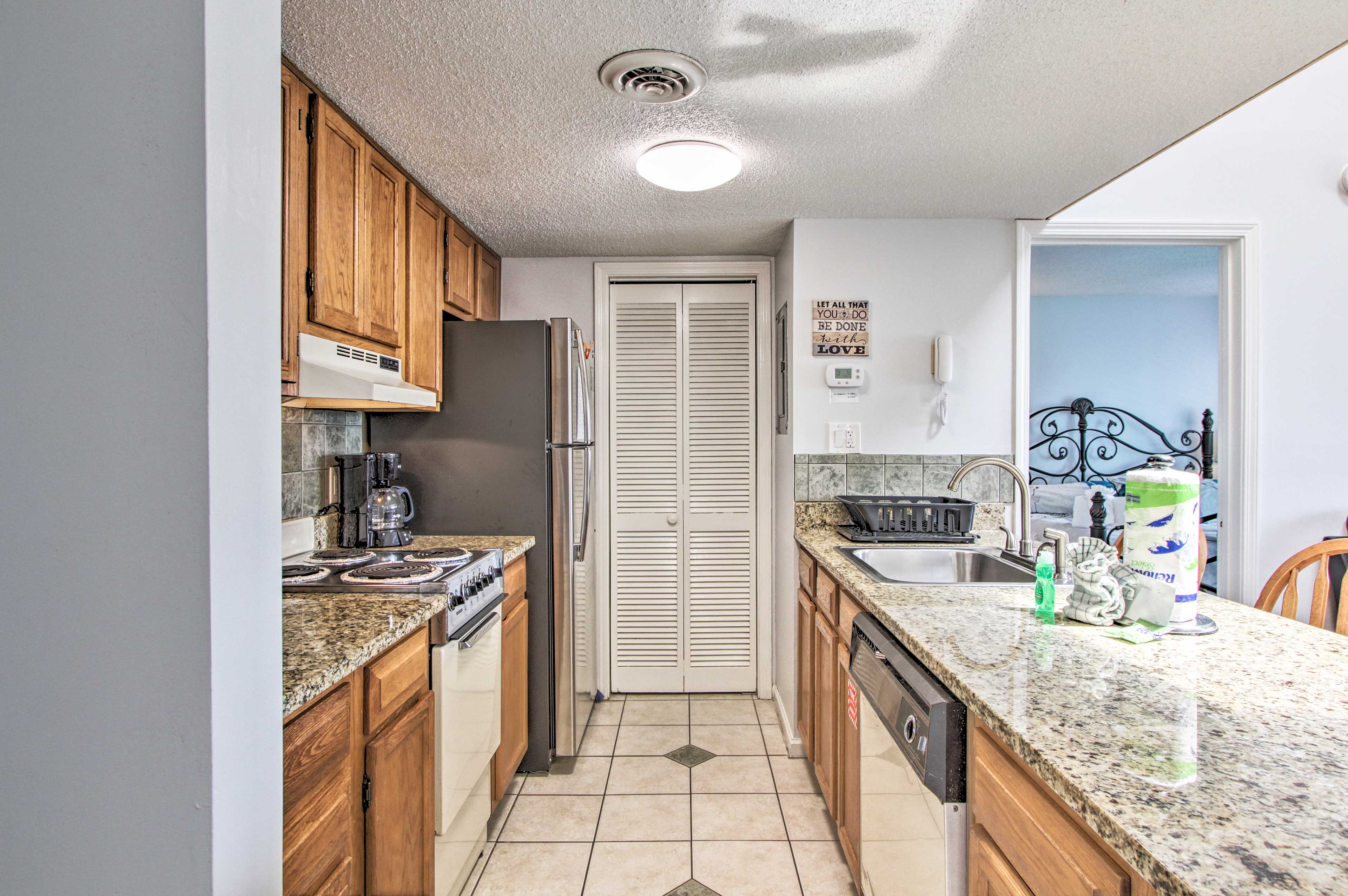 You'll appreciate the kitchen's granite counters and natural wood elements.