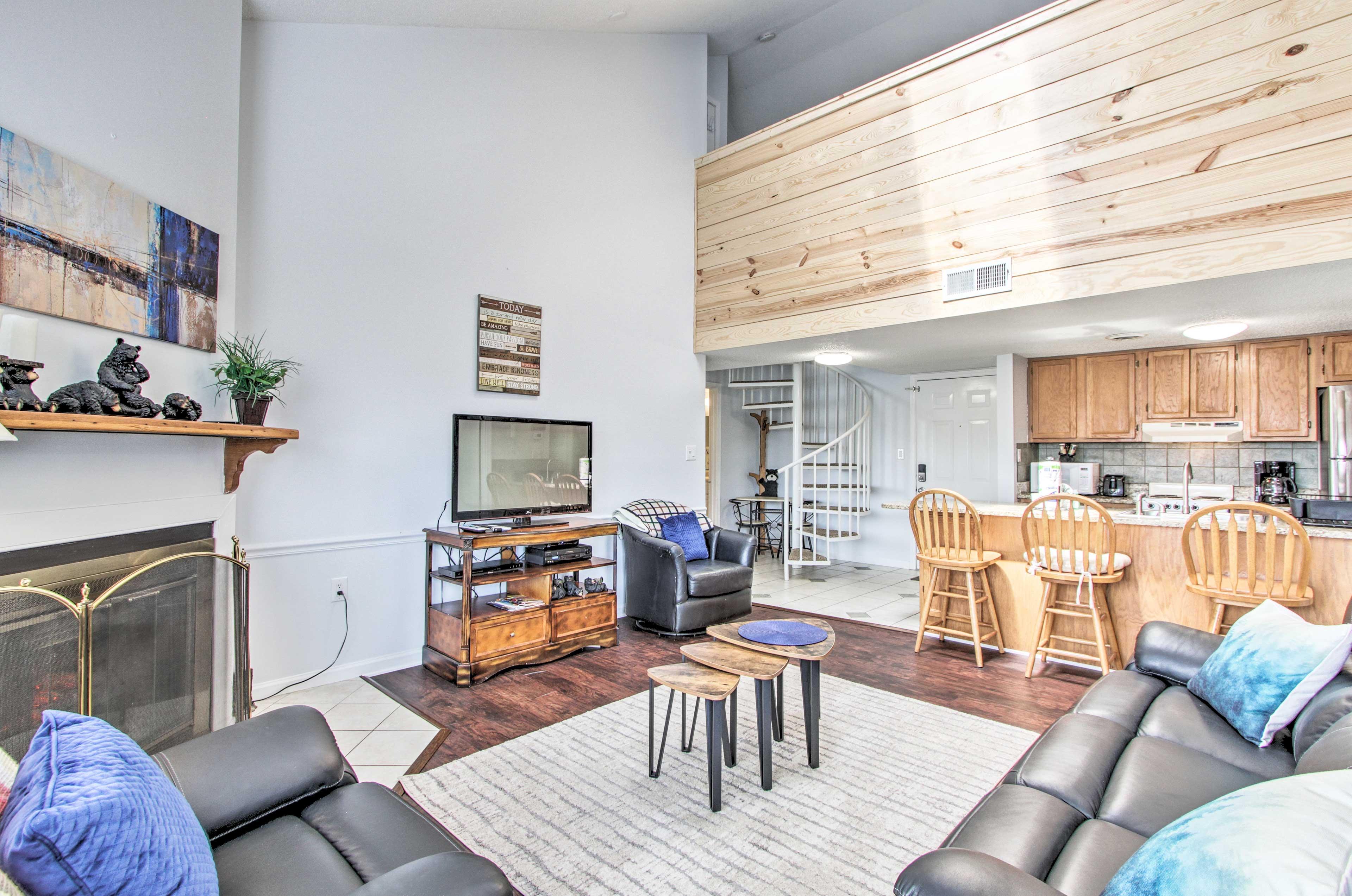 This condo boasts tasteful decor & a spacious open-concept layout.