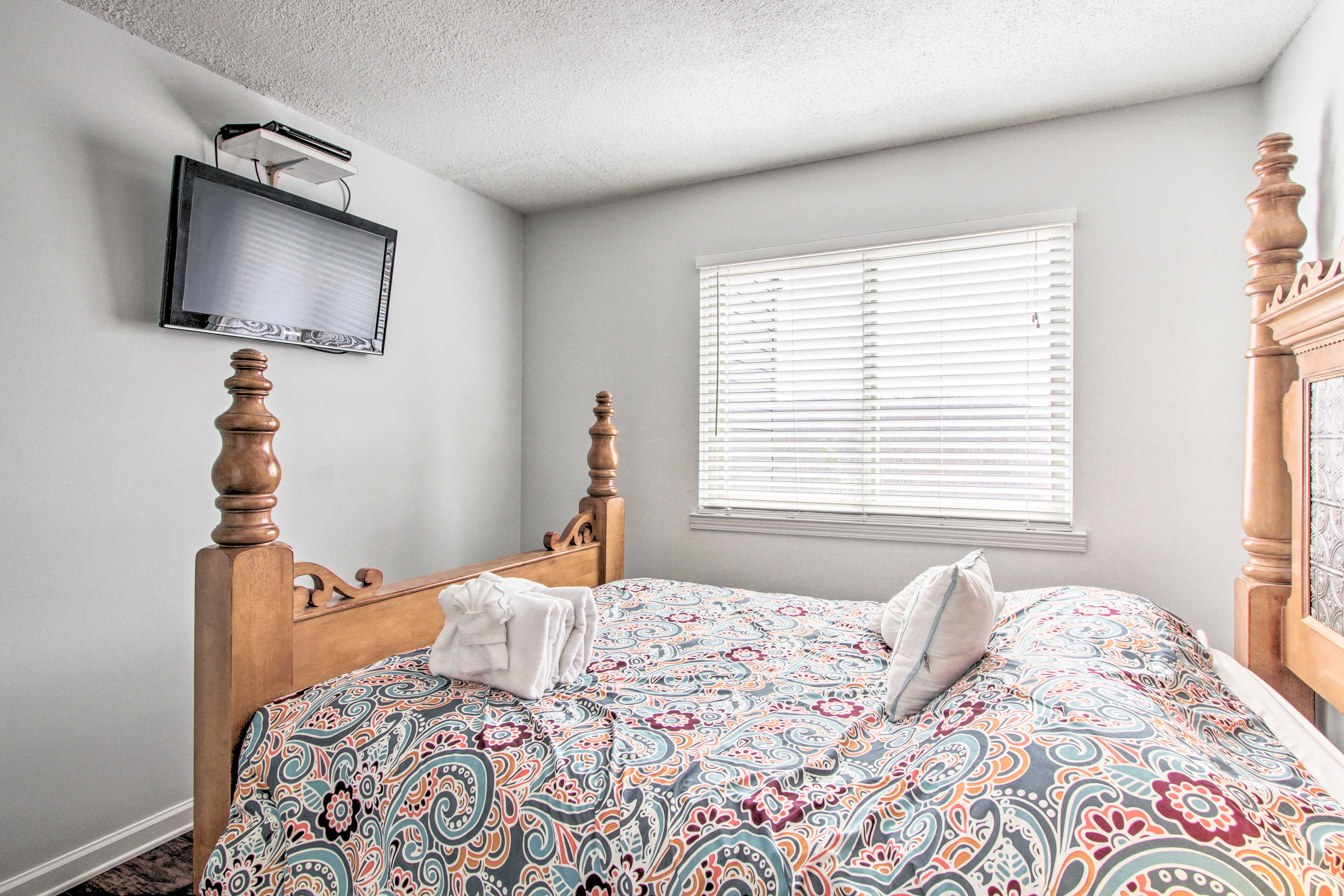 This second bedroom is enchanted in charm by natural wood elements.