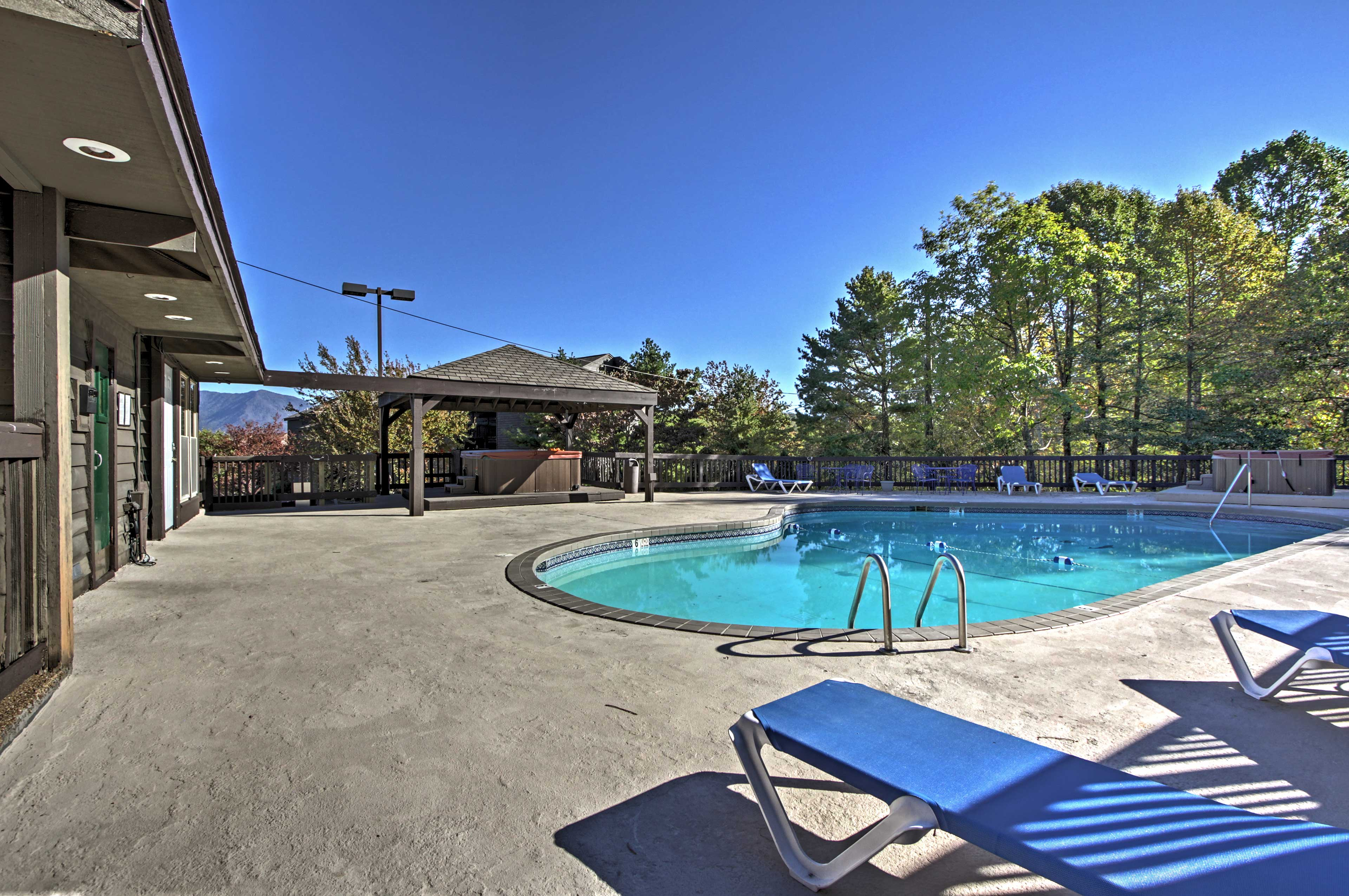 Escape to the Smokies by staying in this 2-bed, 2-bath vacation rental condo.