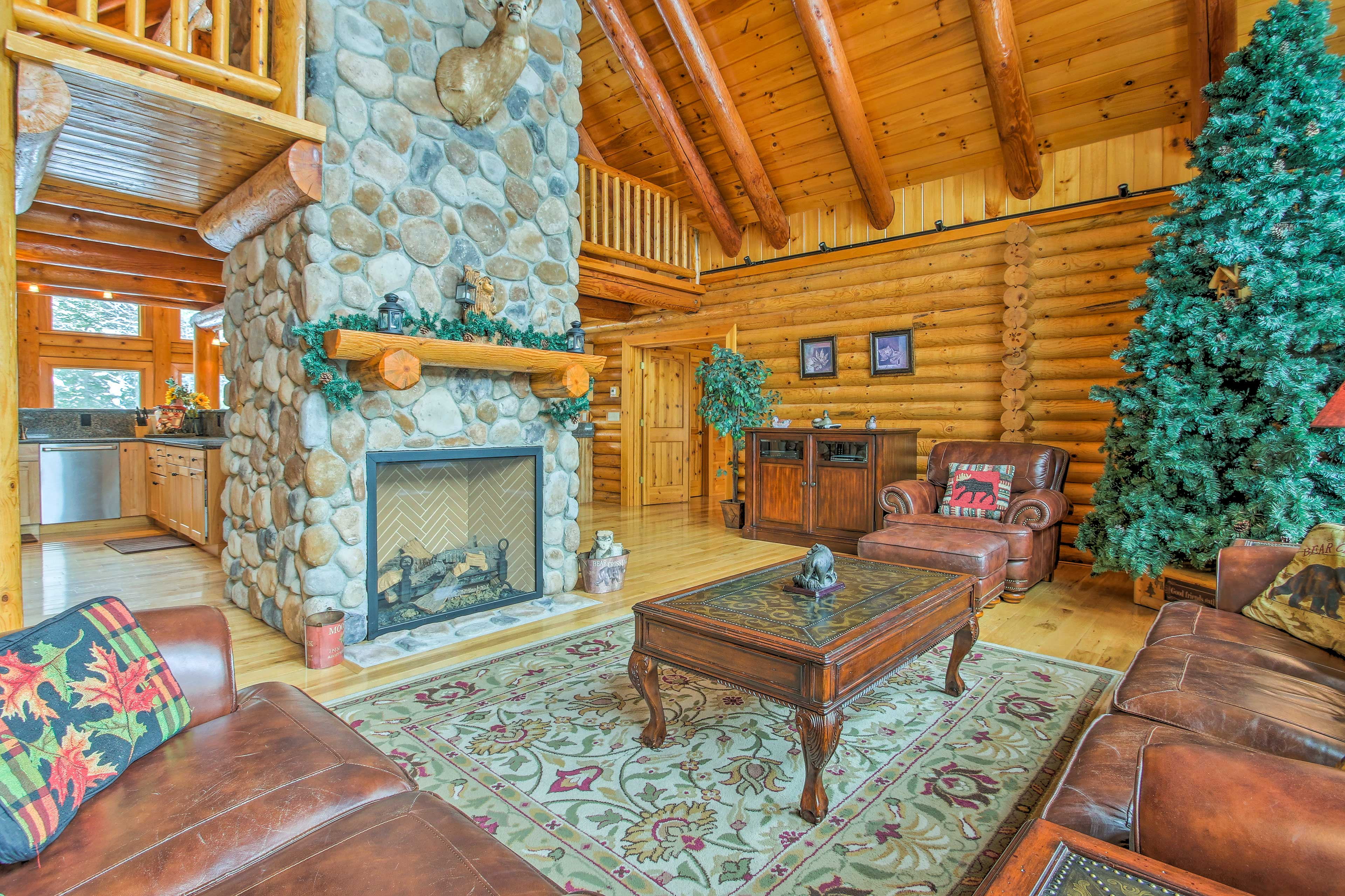 Marvel at the 2-story gas fireplace, the centerpiece of the living space.