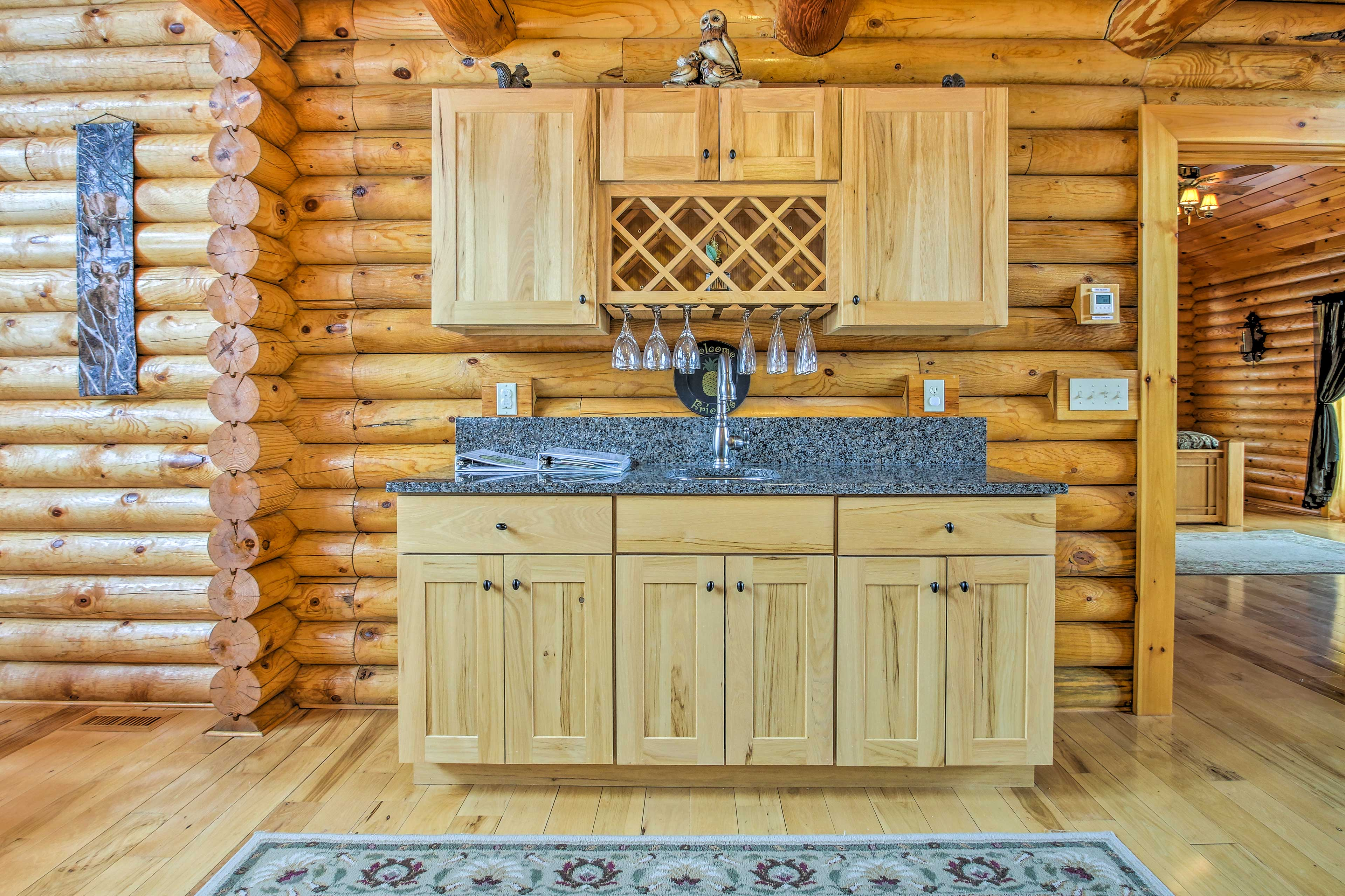The wet bar adds a splash of luxury to the space.