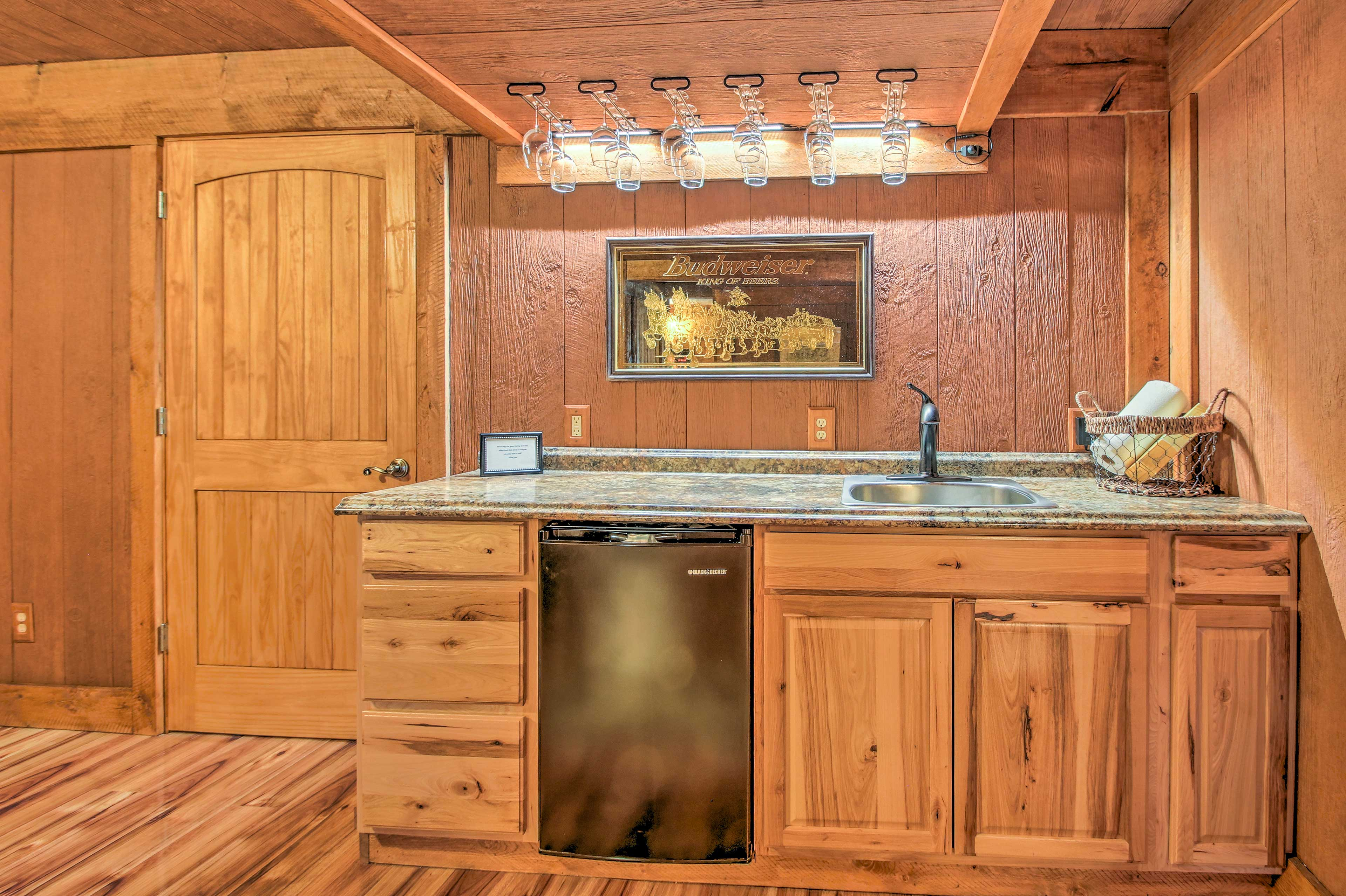 No need to go upstairs for a drink with the wet bar in the basement.