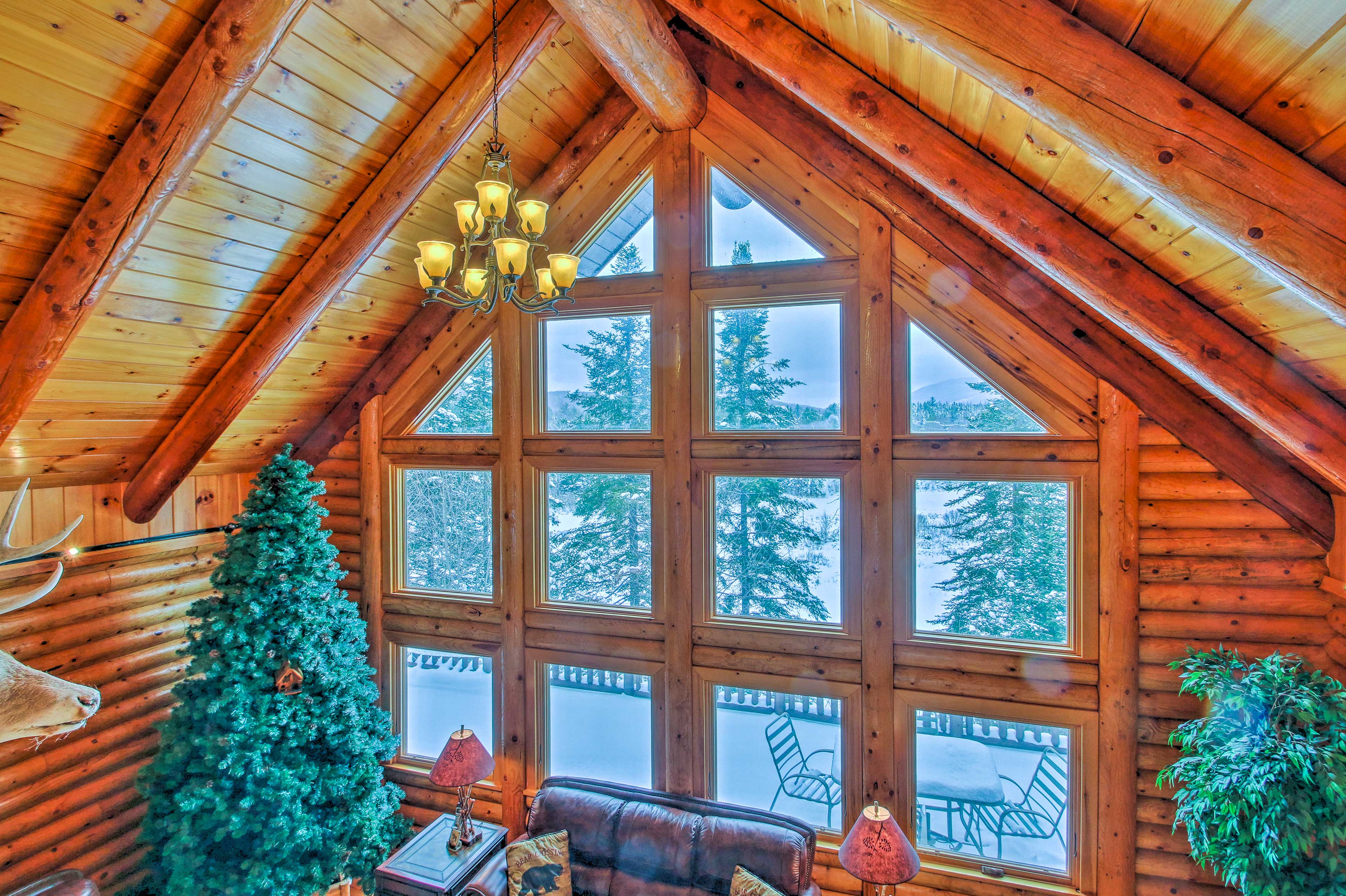 The vaulted wood-beam ceiling adds to the character of the cabin.