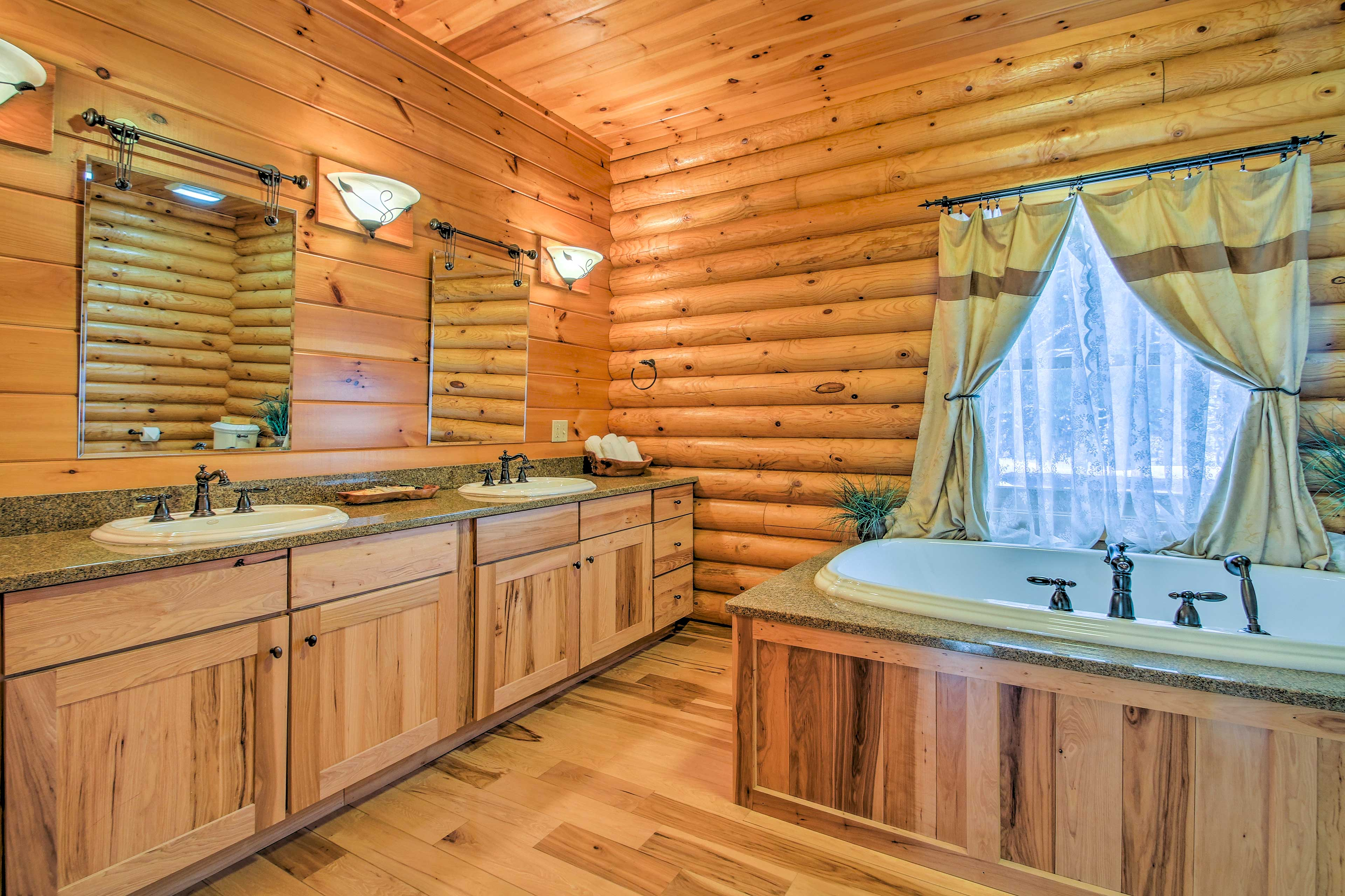 The en-suite master bath offers a walk-in shower and Jacuzzi tub.