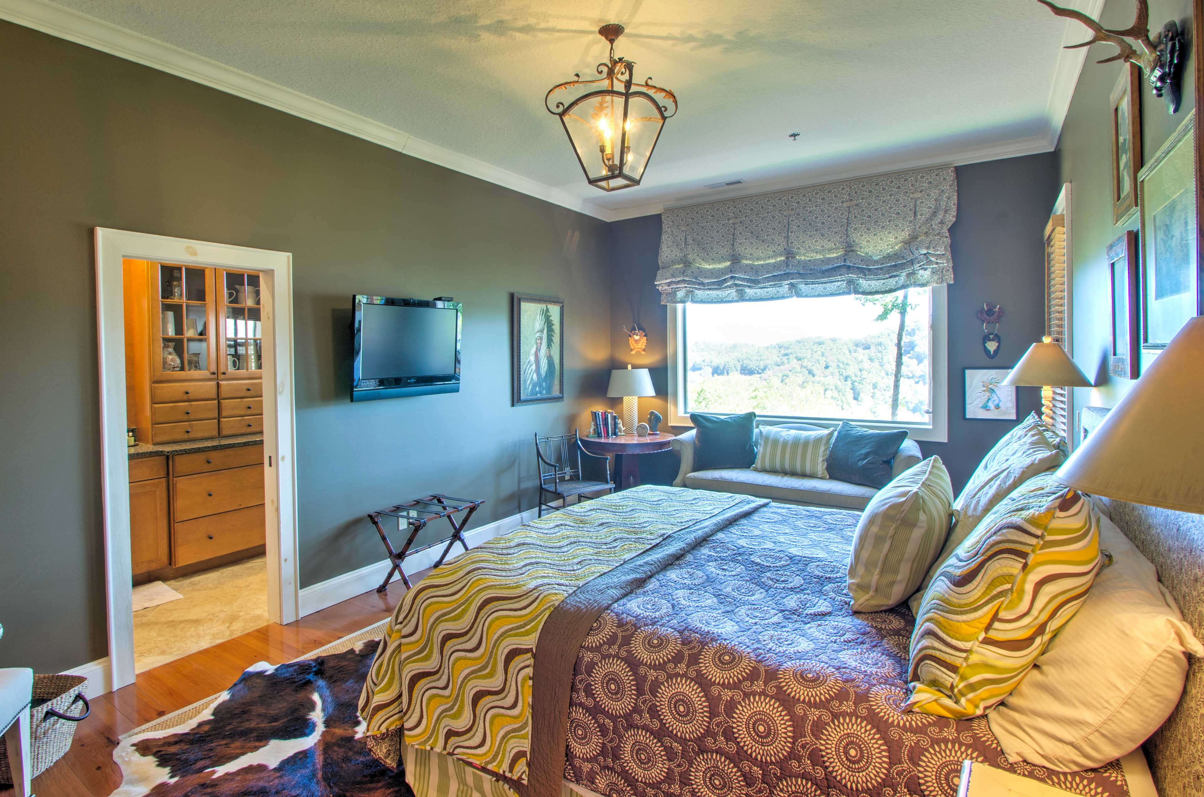 In the master bedroom, you'll also find a flat-screen cable TV & mountain views!