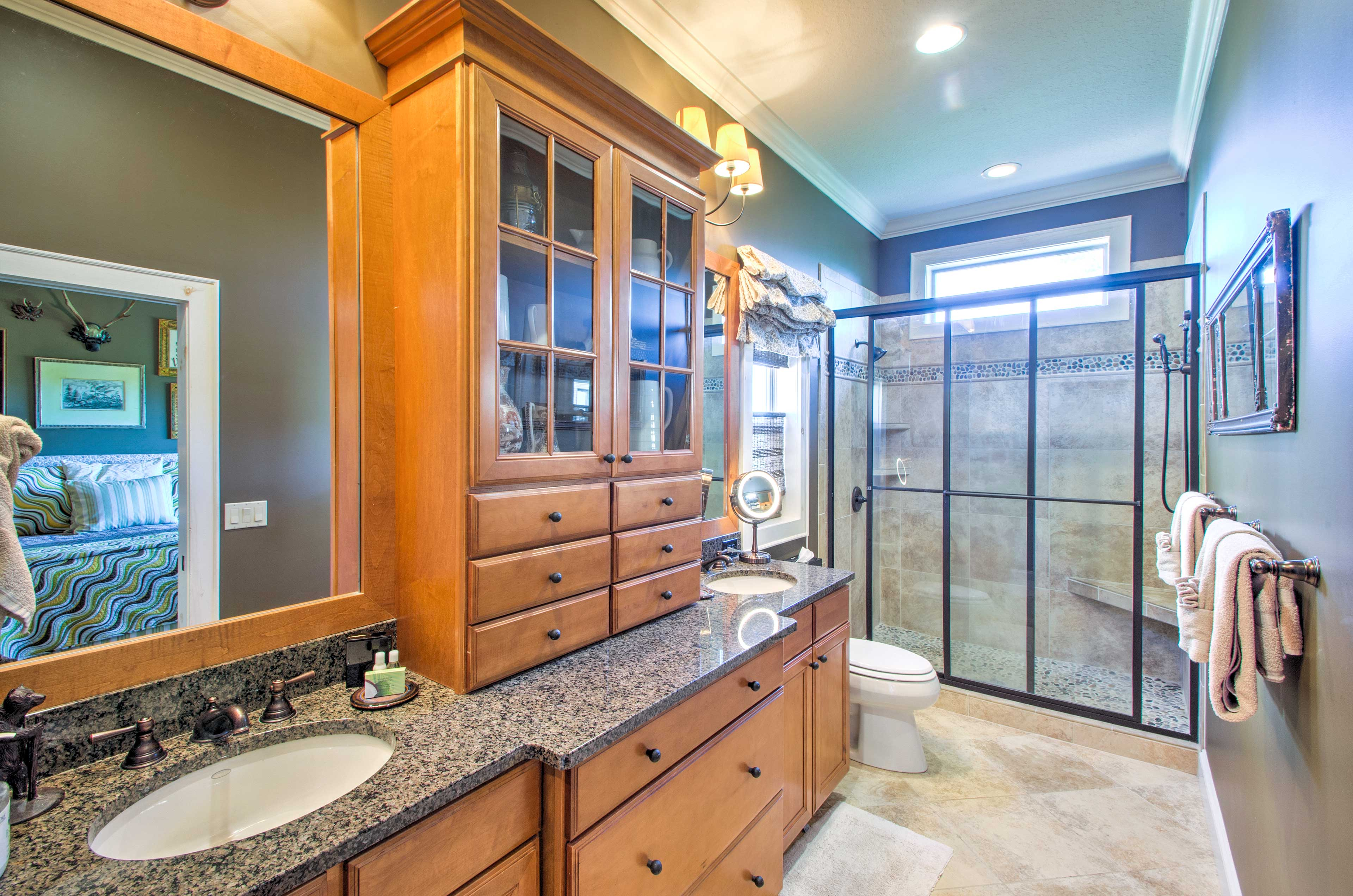 The master's en-suite bathroom features a double vanity and walk-in shower.
