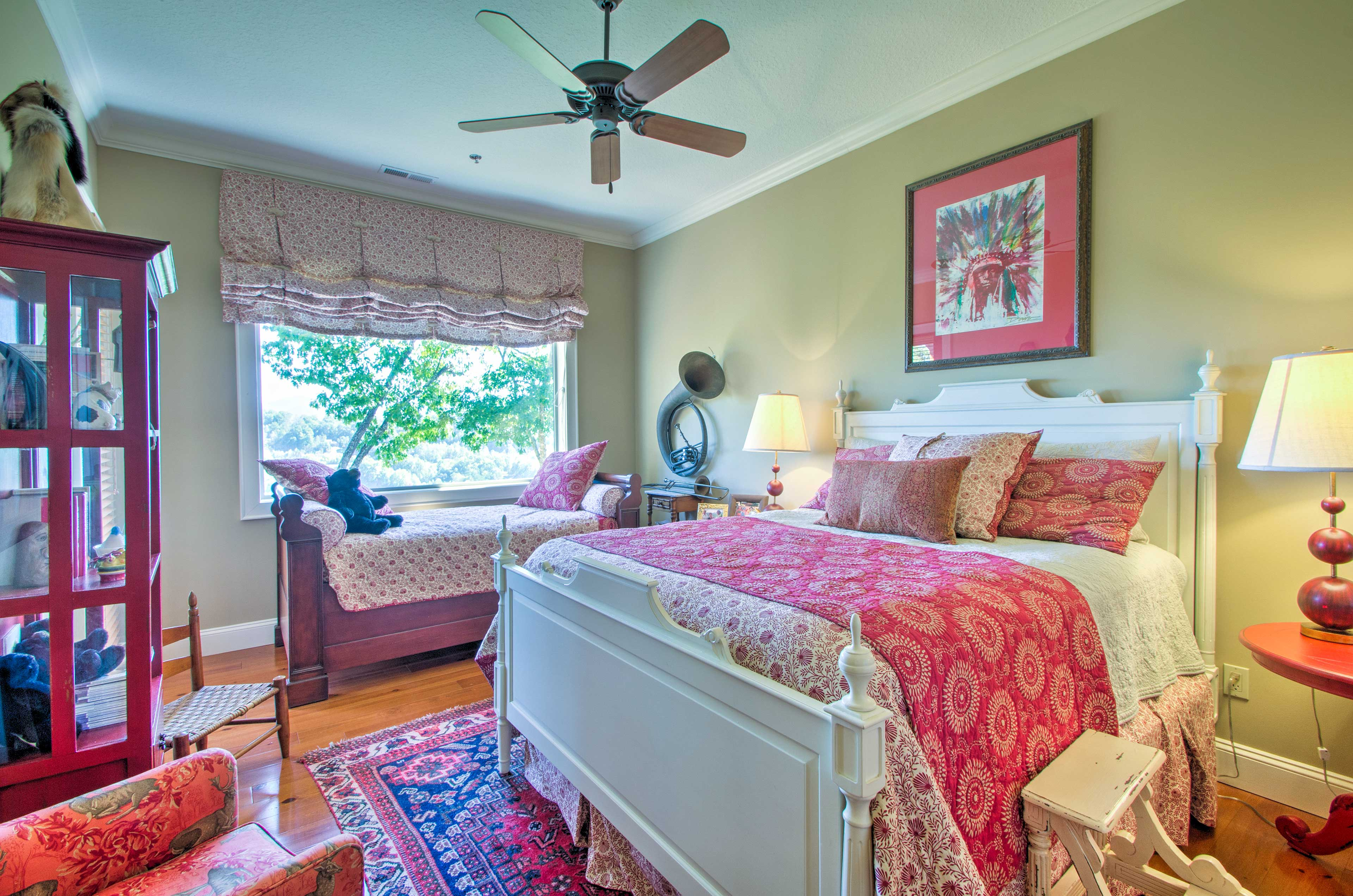 The second bedroom offers a queen bed and twin daybed.