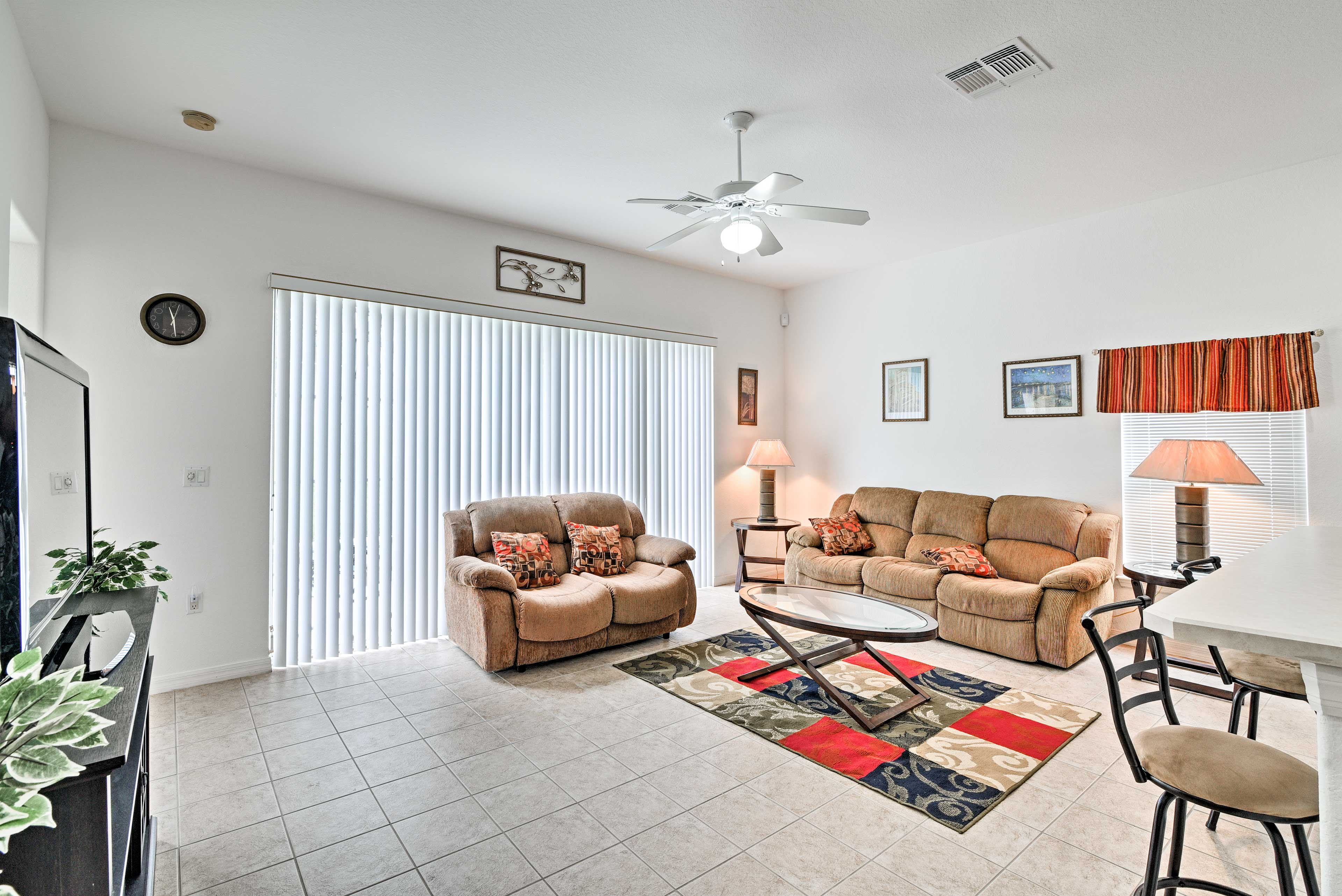 Unwind on the comfy couch in the living room.