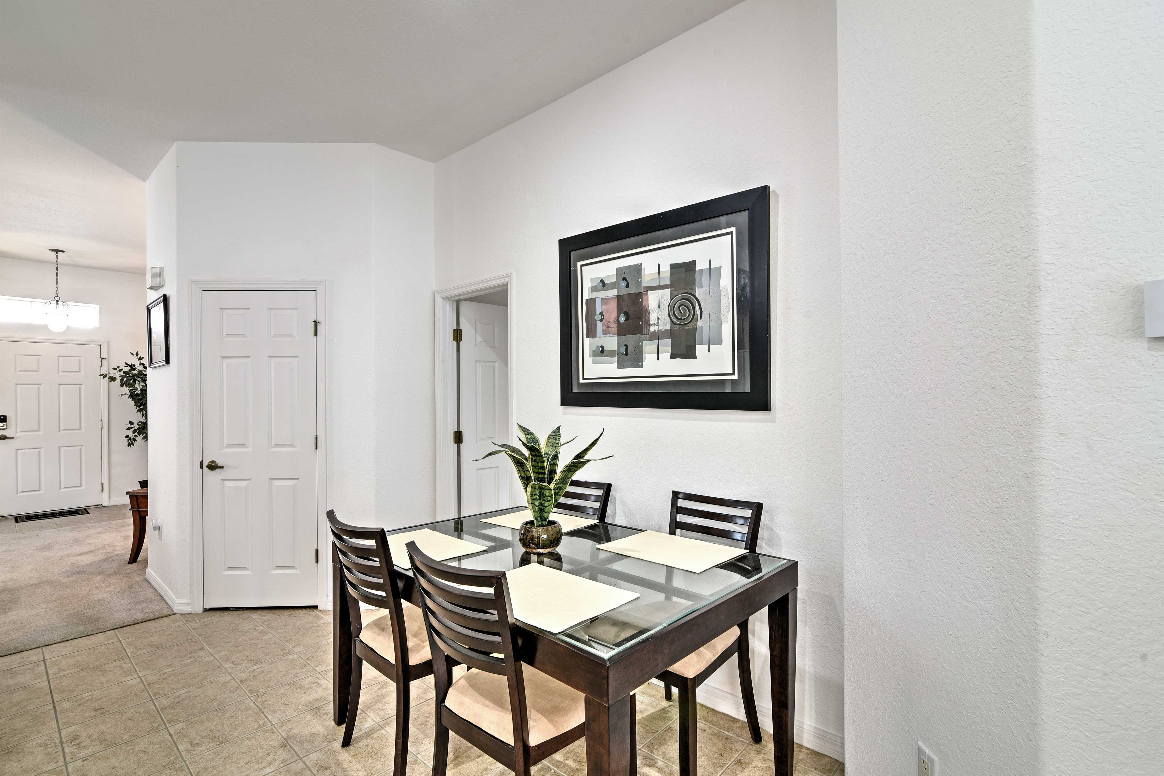 Enjoy a nice meal or play a game of cards at the table with seating for 4.