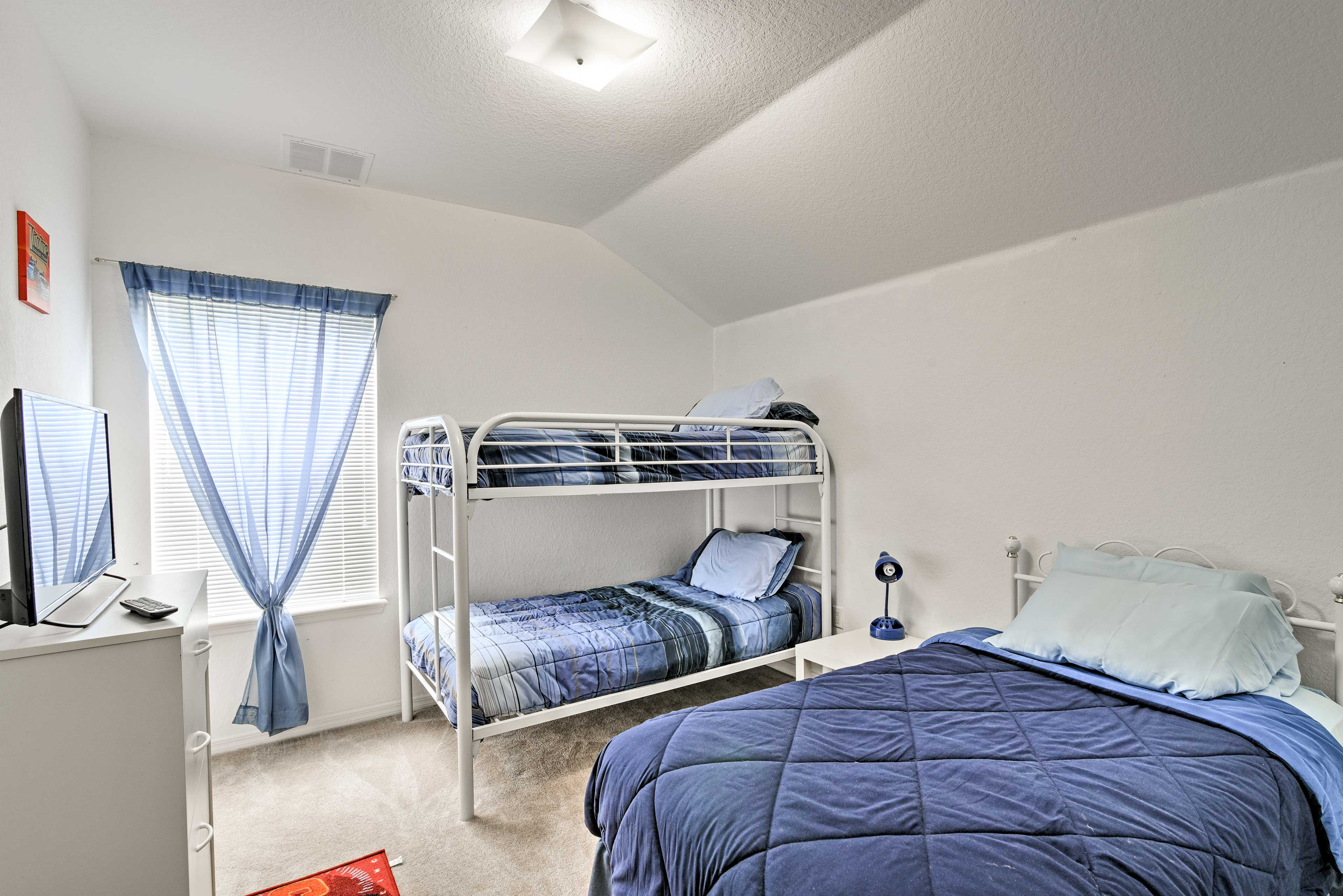 The third bedroom has a twin-sized bed and a twin-over-twin bunk bed.