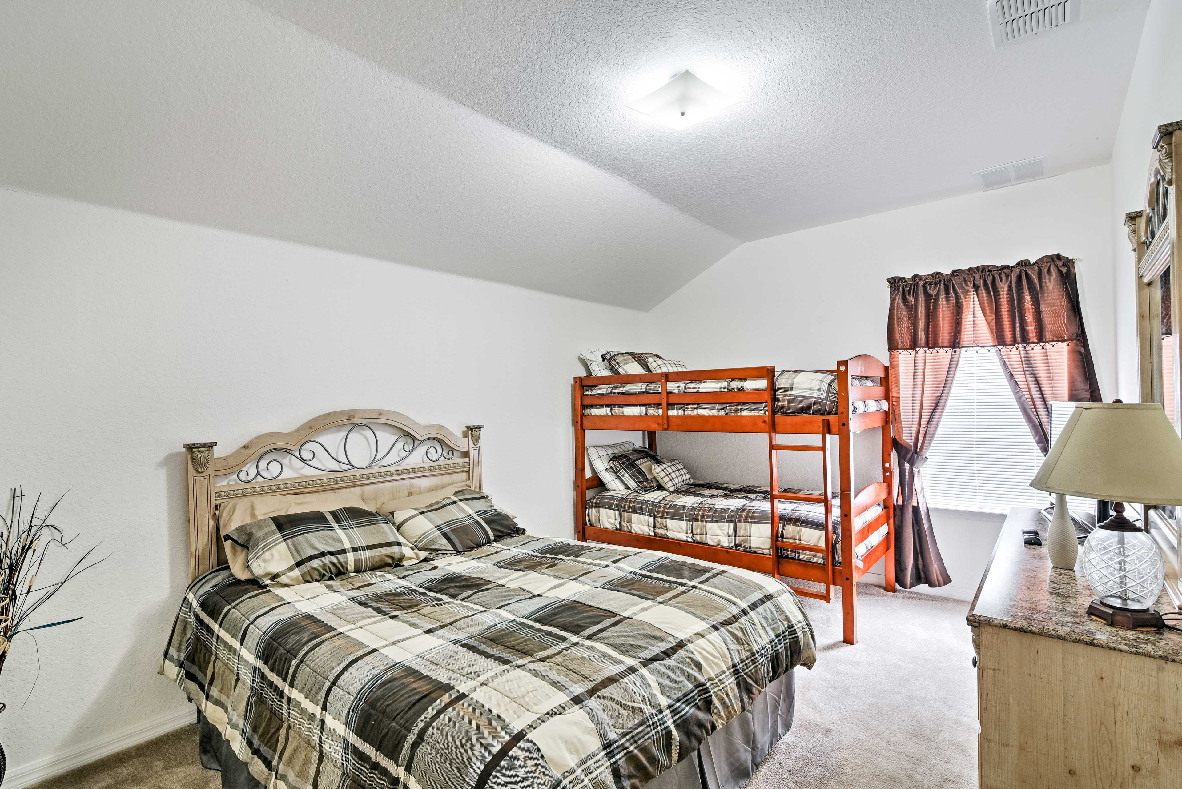 The spacious fourth bedroom has a queen bed and a twin-over-twin bunk bed.