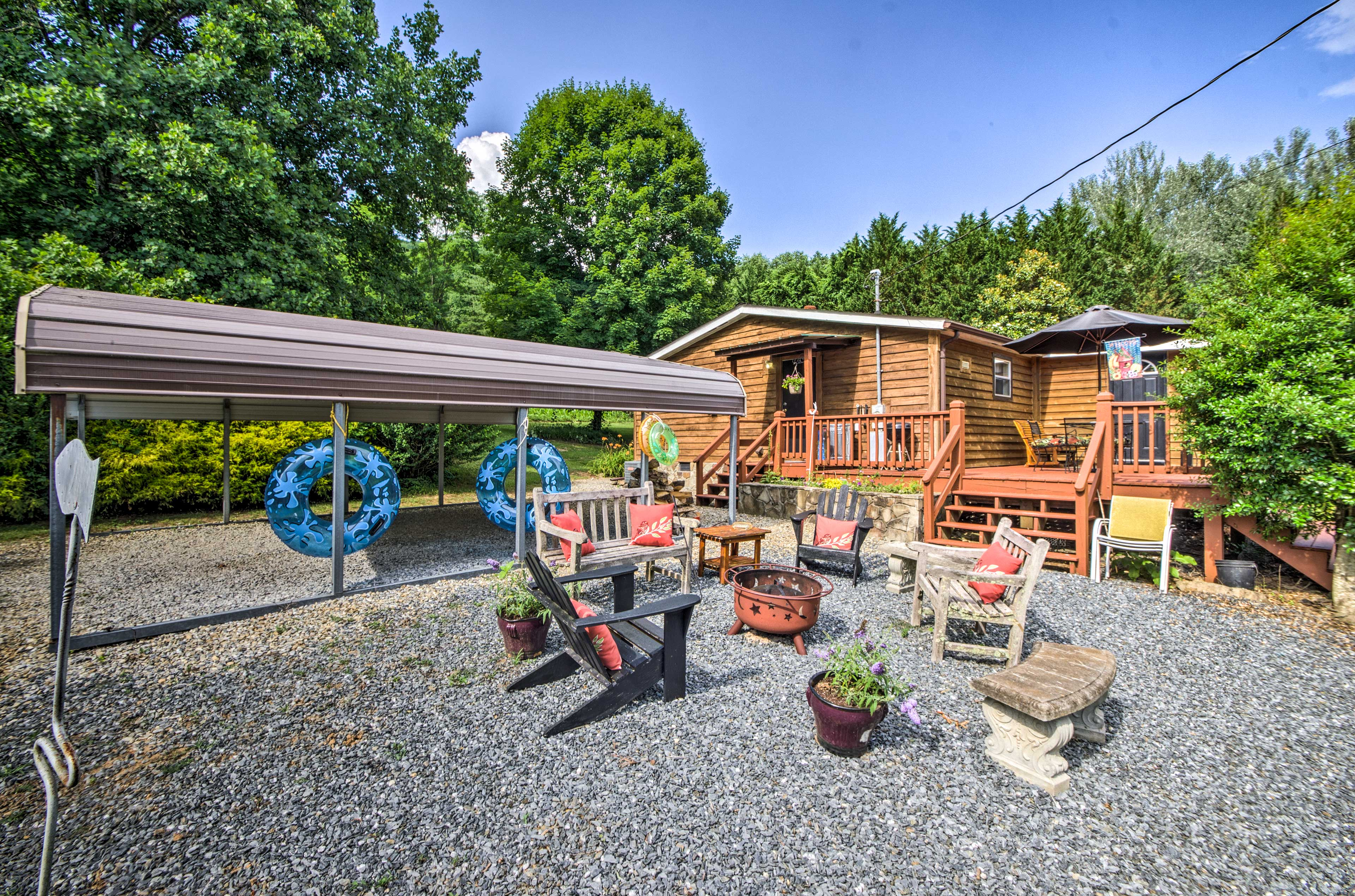 The home offers a fire pit, covered parking, and a quiet escape!