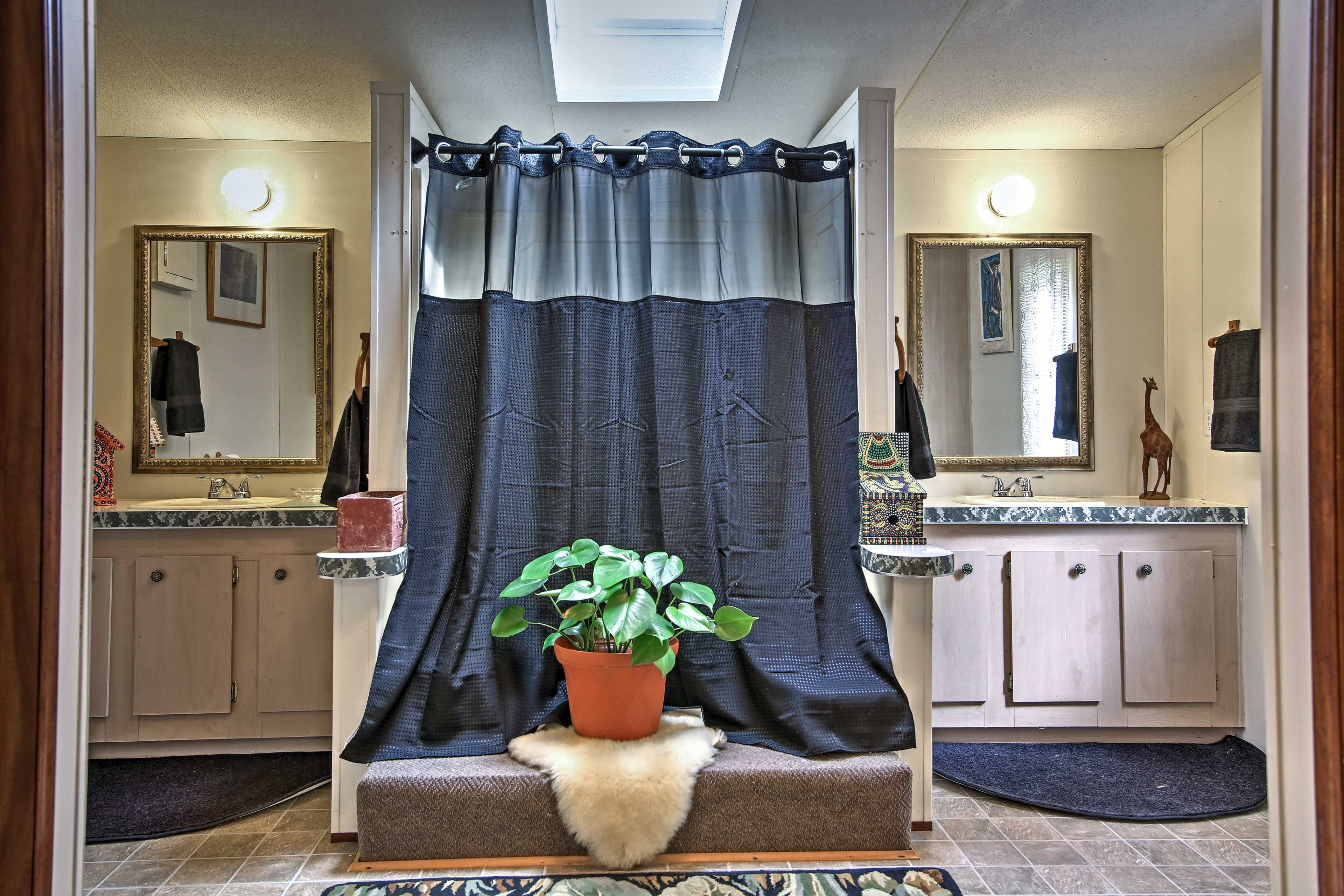 The master bathroom offers a spacious layout and dual vanities.