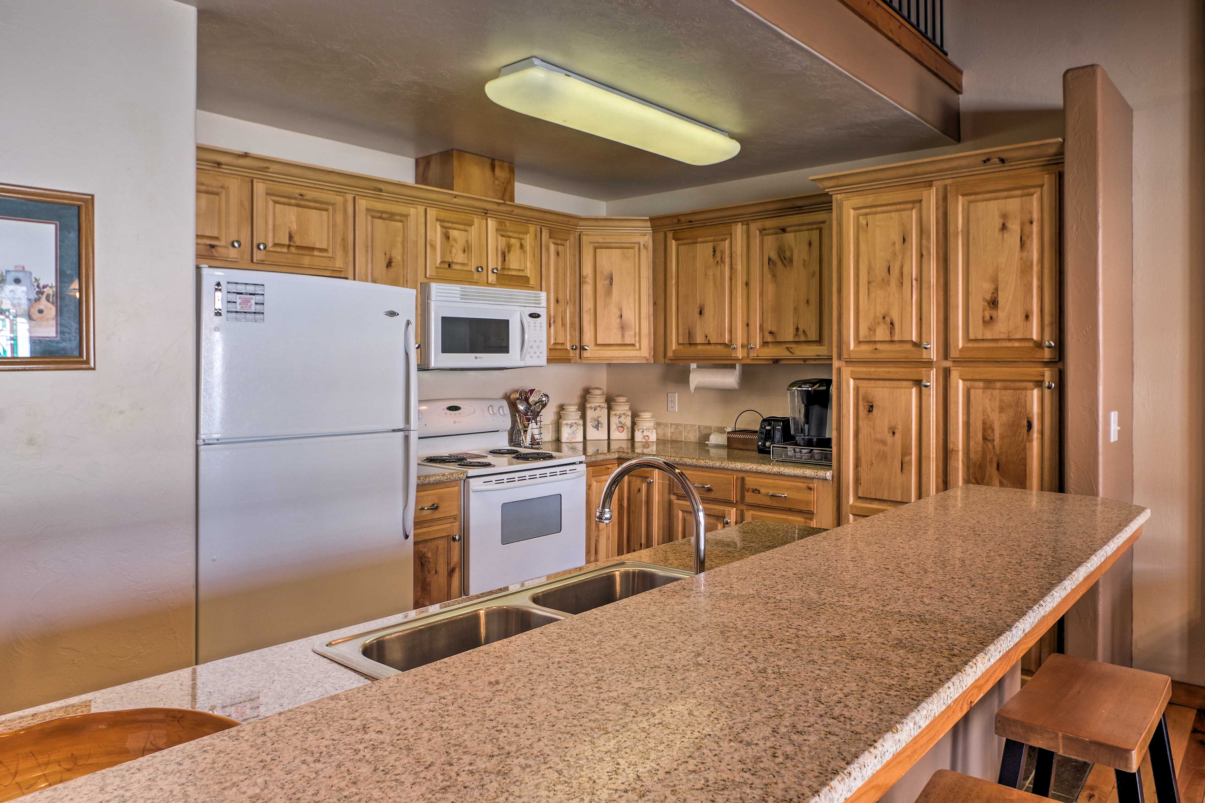 This spacious kitchen boasts granite countertops and modern appliances.