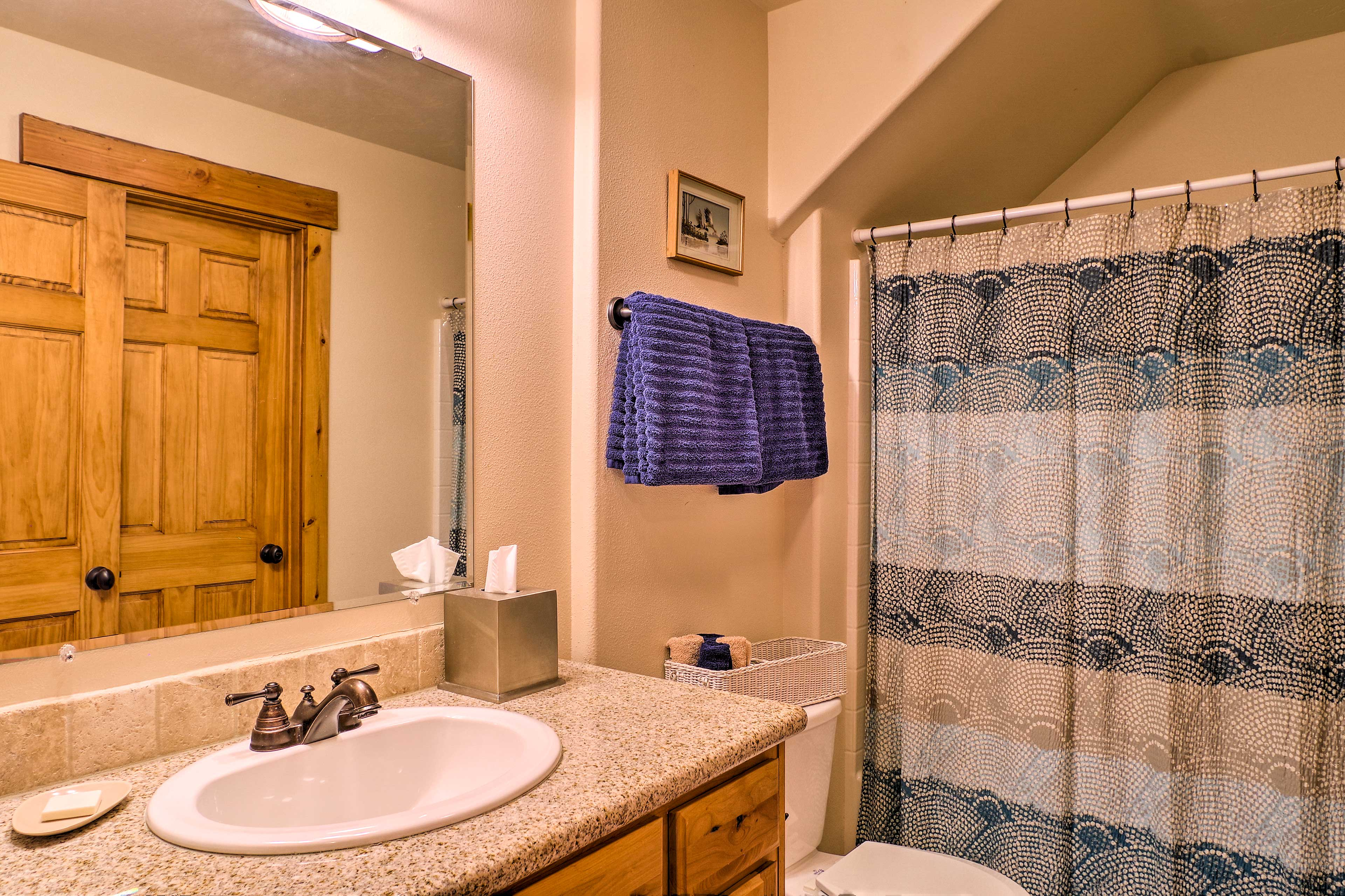 Rise and shine with a refreshing shower in the full bathroom.