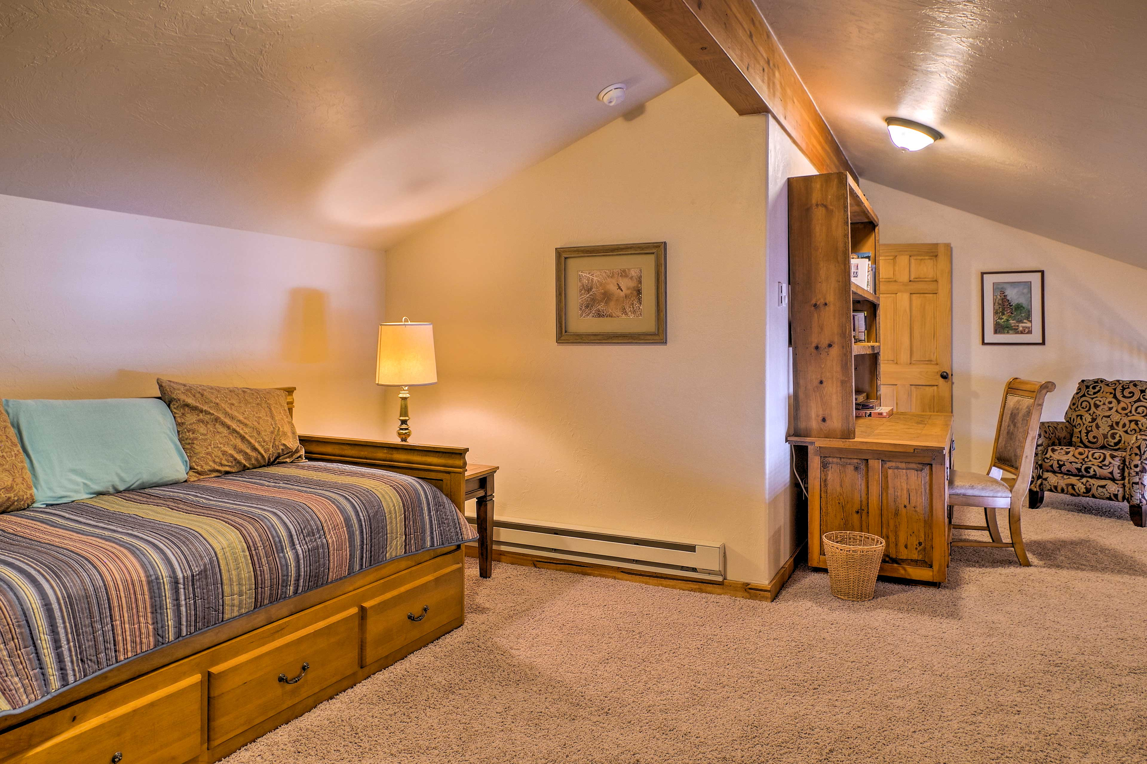 For additional sleeping, retreat to the loft and cozy up on the day bed.