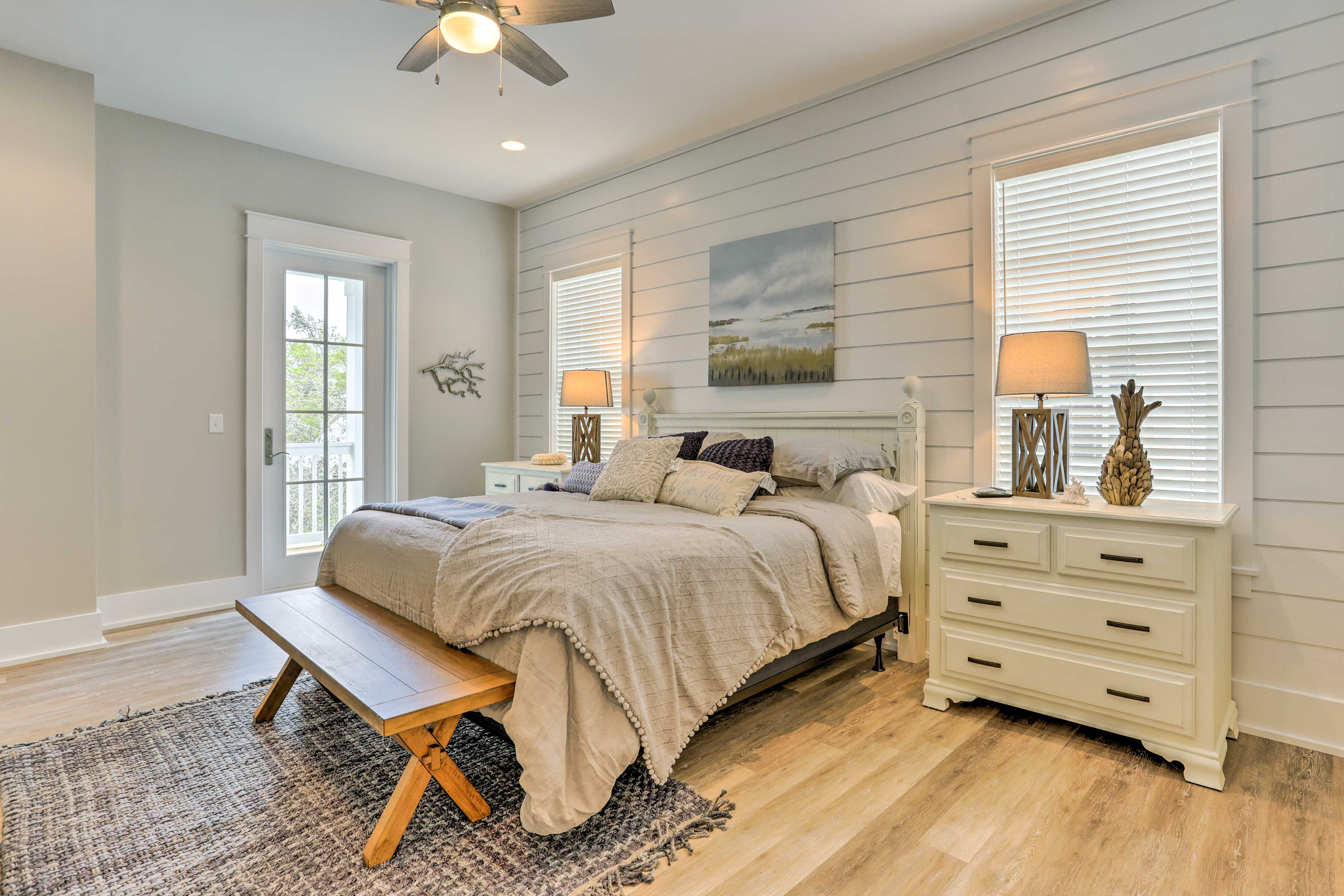 The first master bedroom boasts a plush king bed.