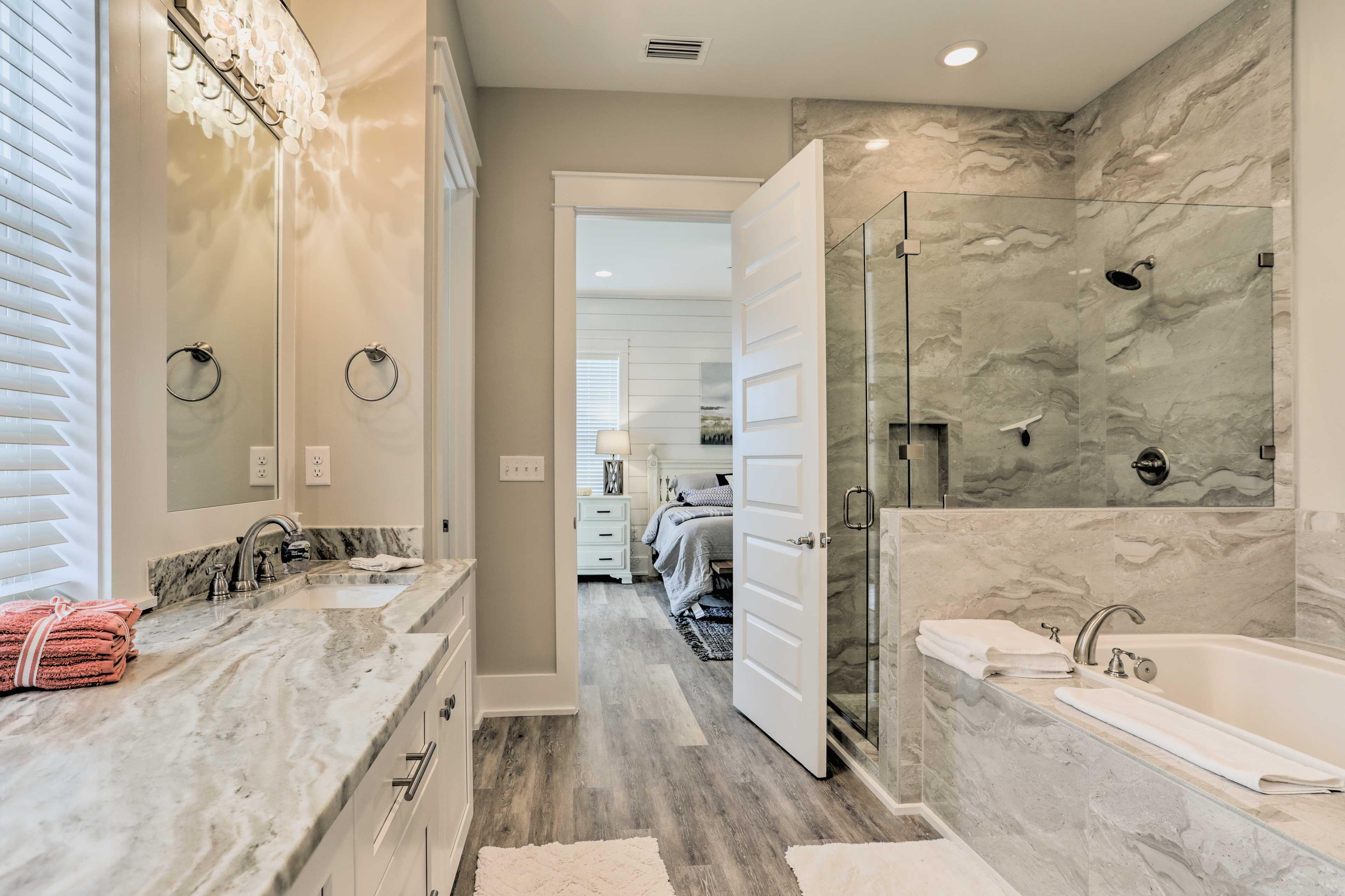 Enjoy a relaxing soak in the master bathroom tub.