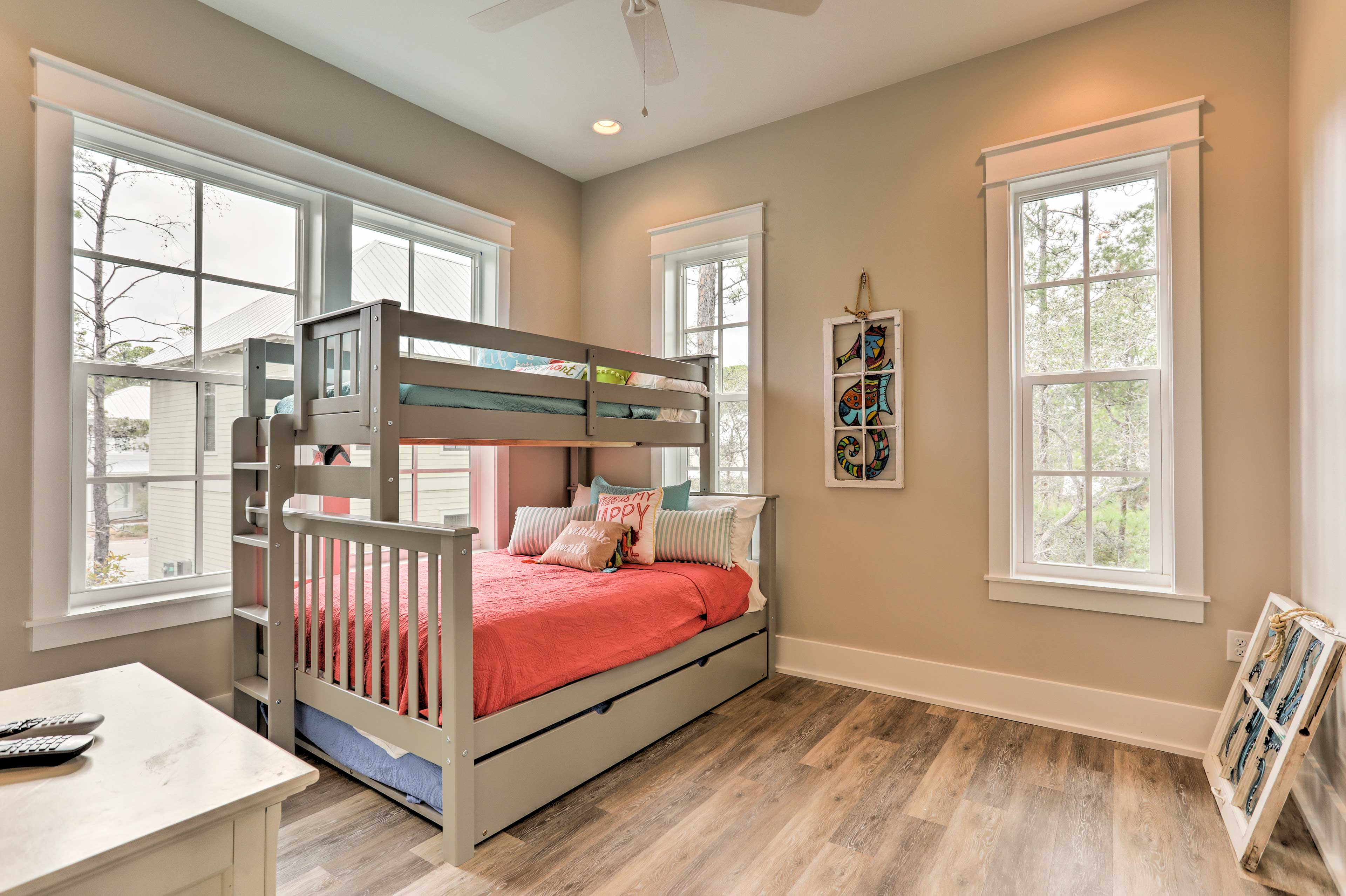 Kids will love this room with a twin-over-full bunk bed and twin trundle.
