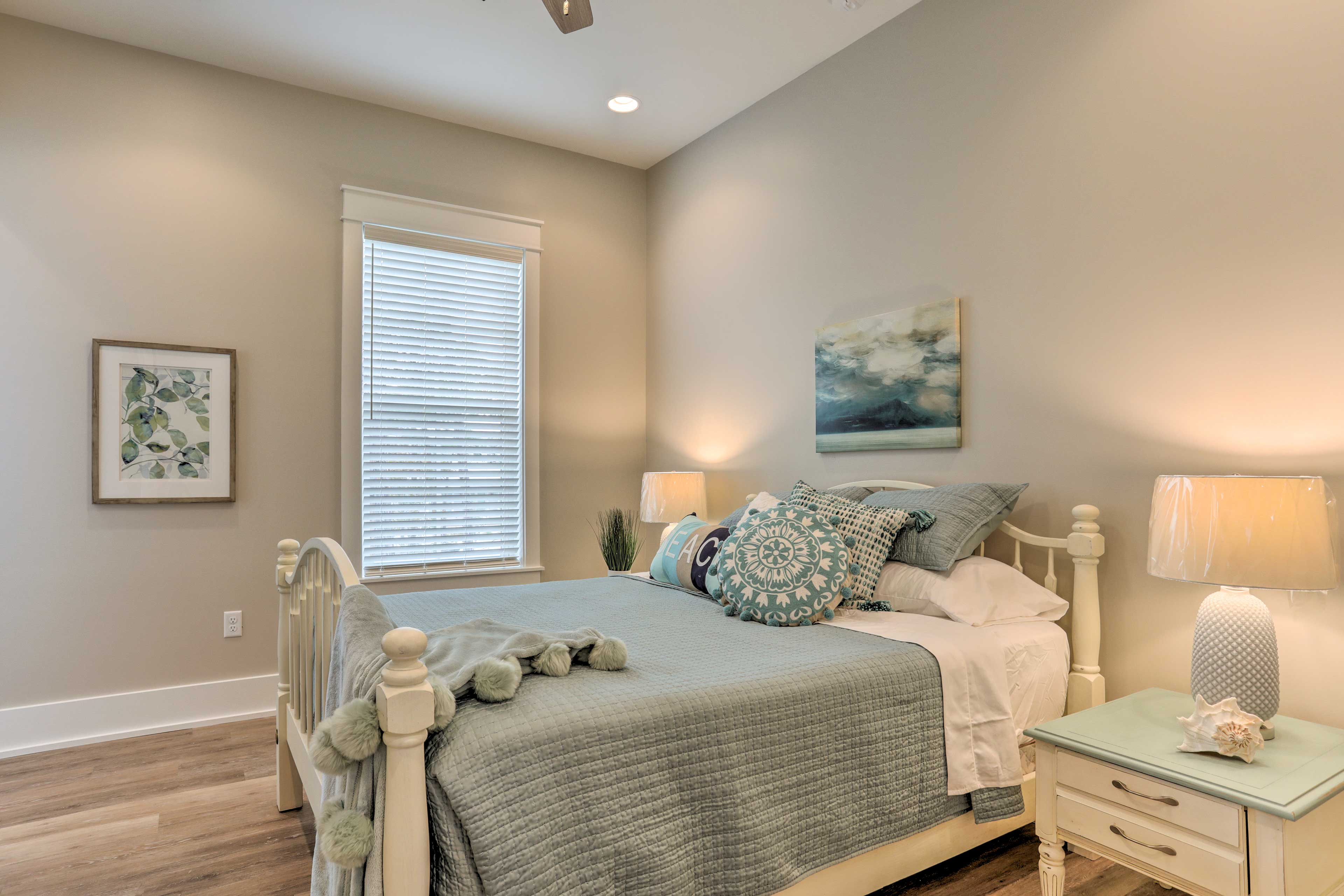The fourth bedroom includes a queen bed.