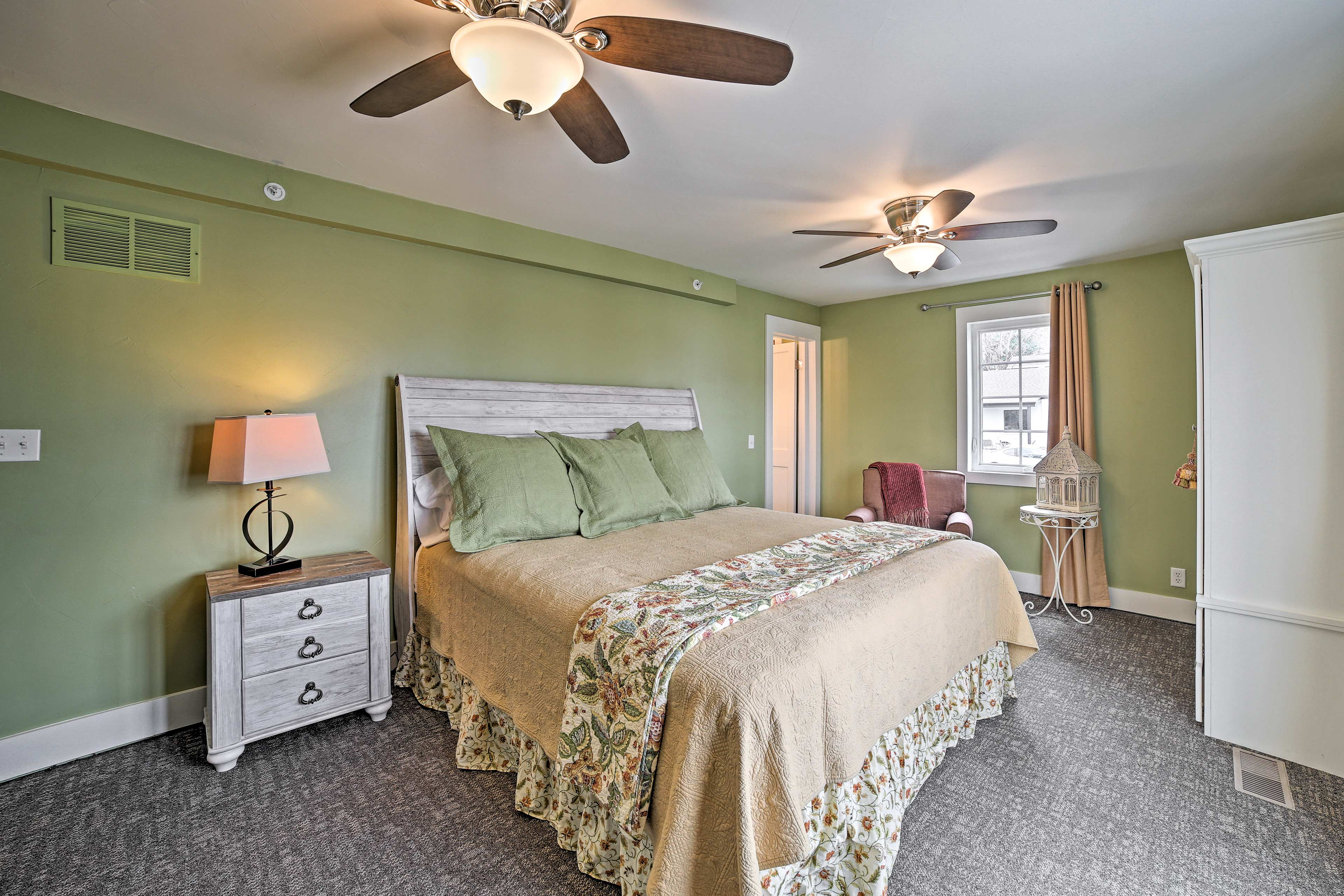 This room now features a king bed and a twin-over-twin bunk bed.