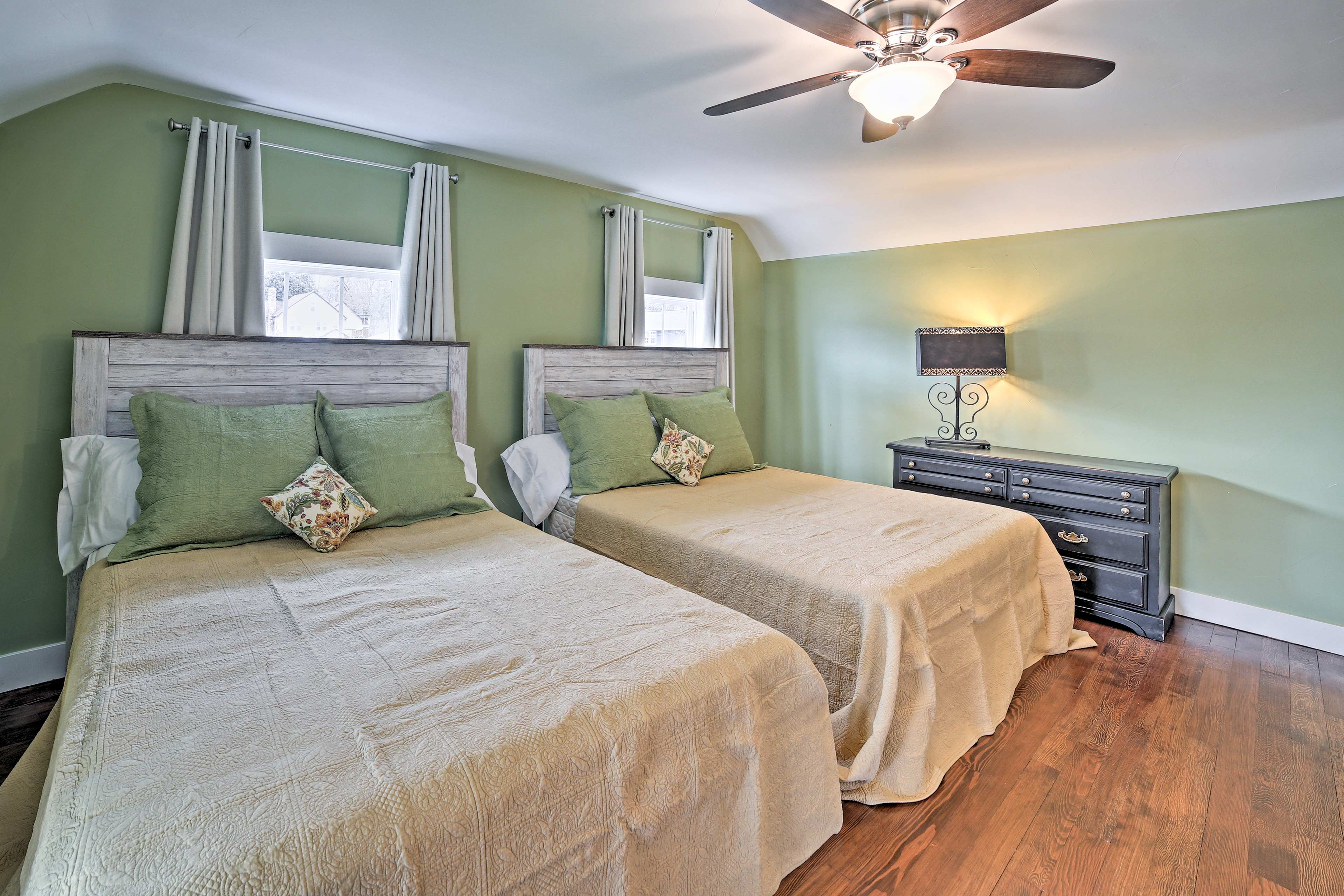 This bedroom boasts 2 queen beds that easily sleep 4 guests.