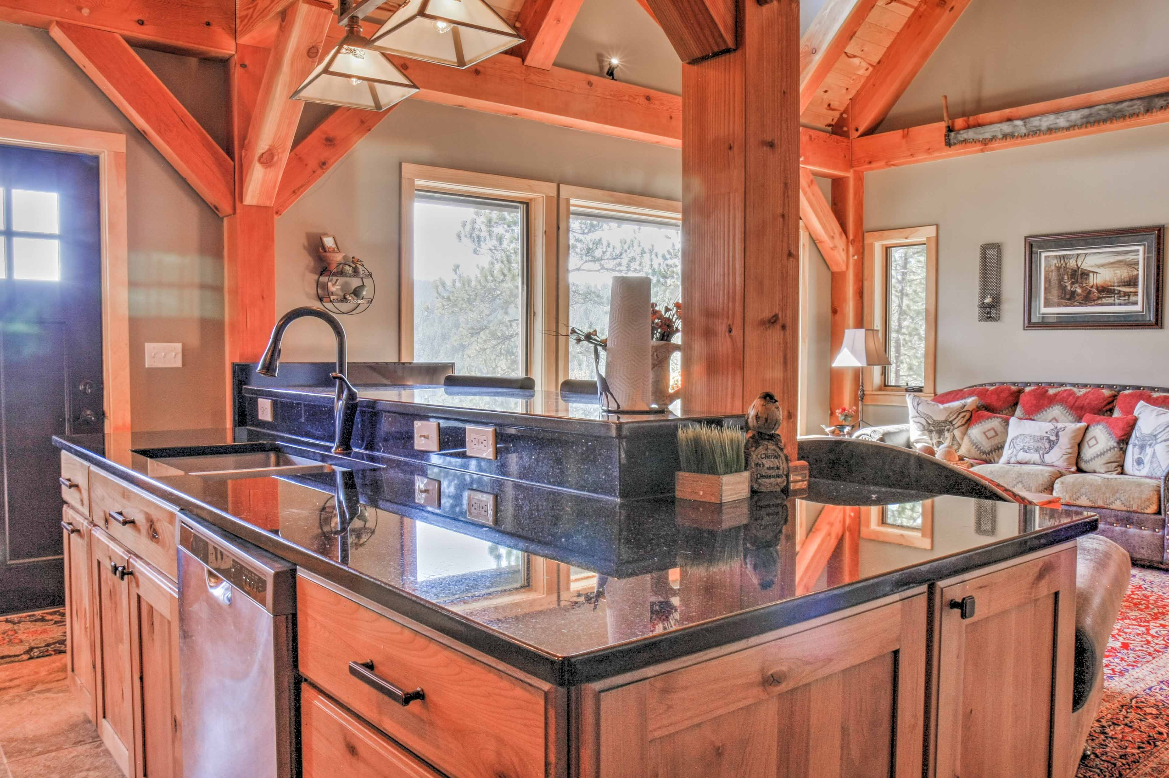 The home features sleek granite counters throughout.