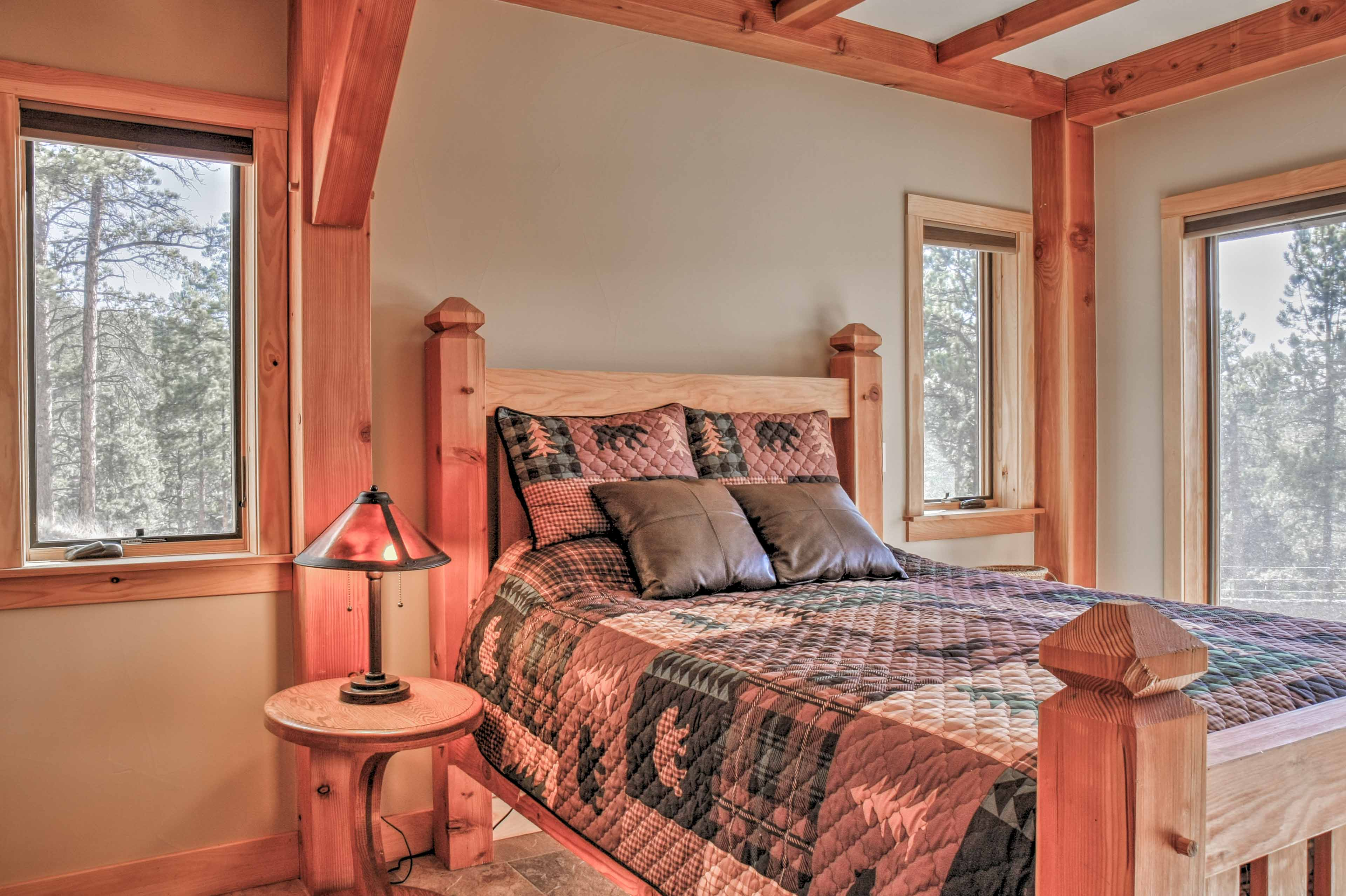 Rest easy on the queen bed in the first bedroom.
