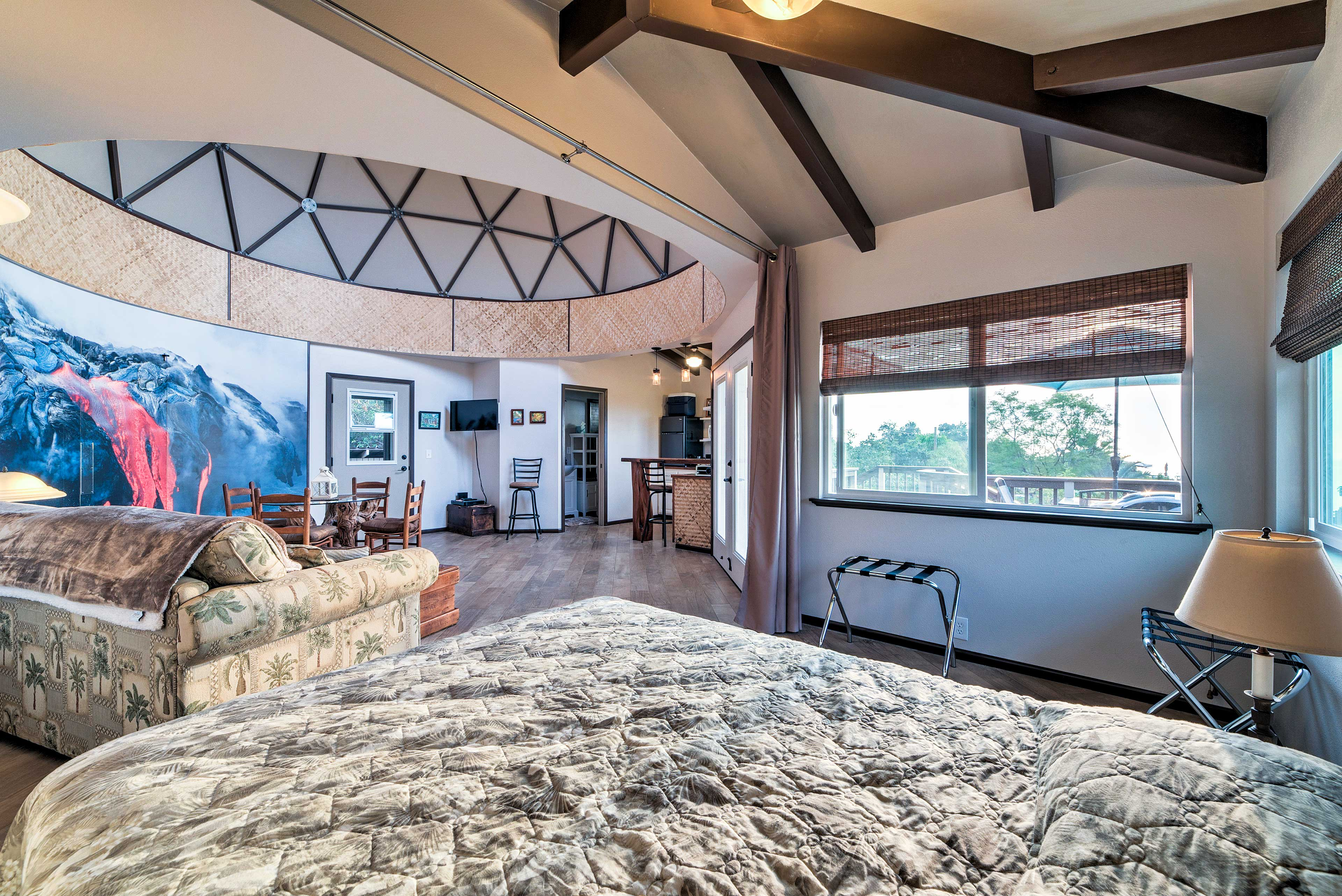 This unique property is complete with a mountain mural and soaring ceilings.