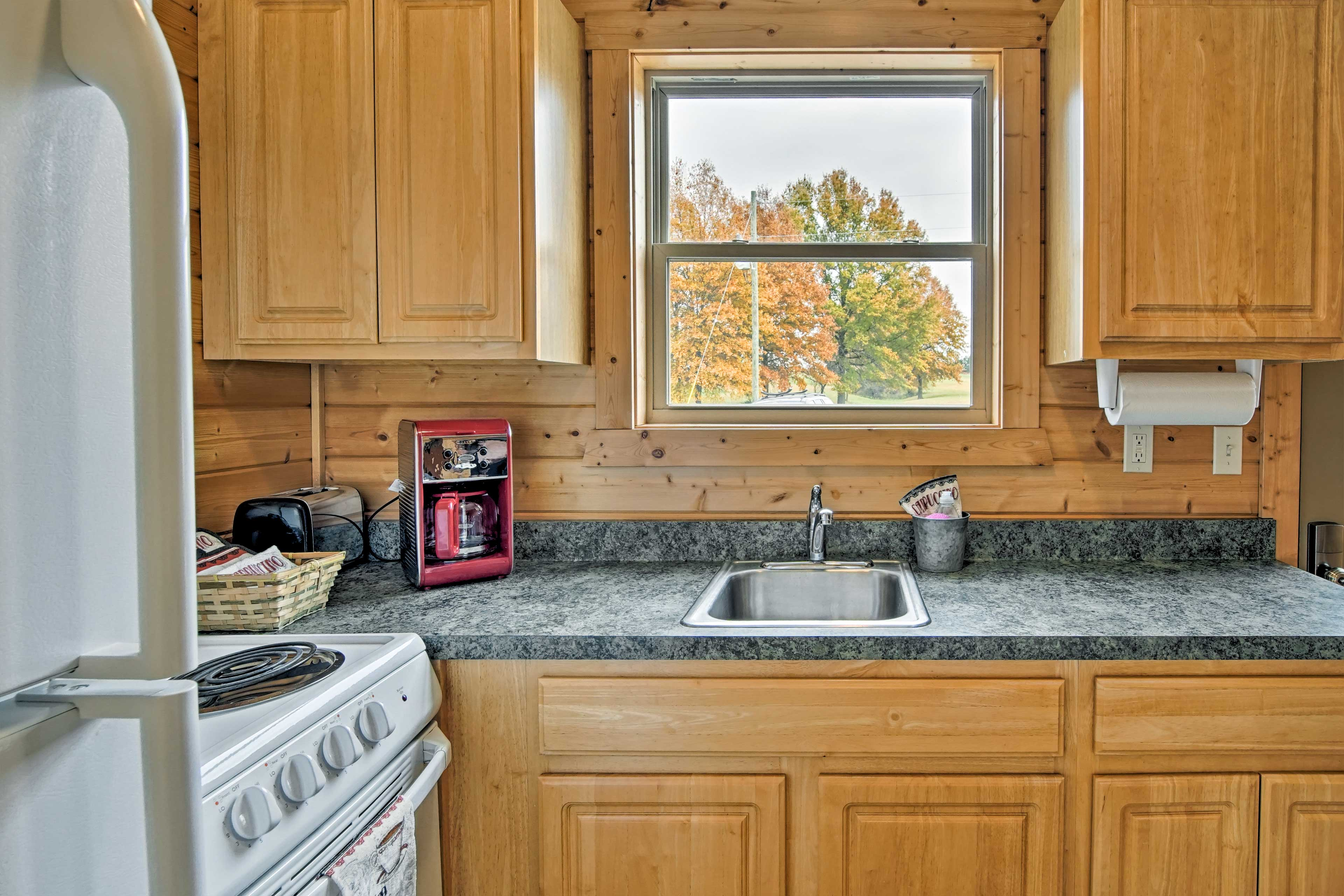 Look out onto beautiful scenery while doing the dishes in the kitchen.