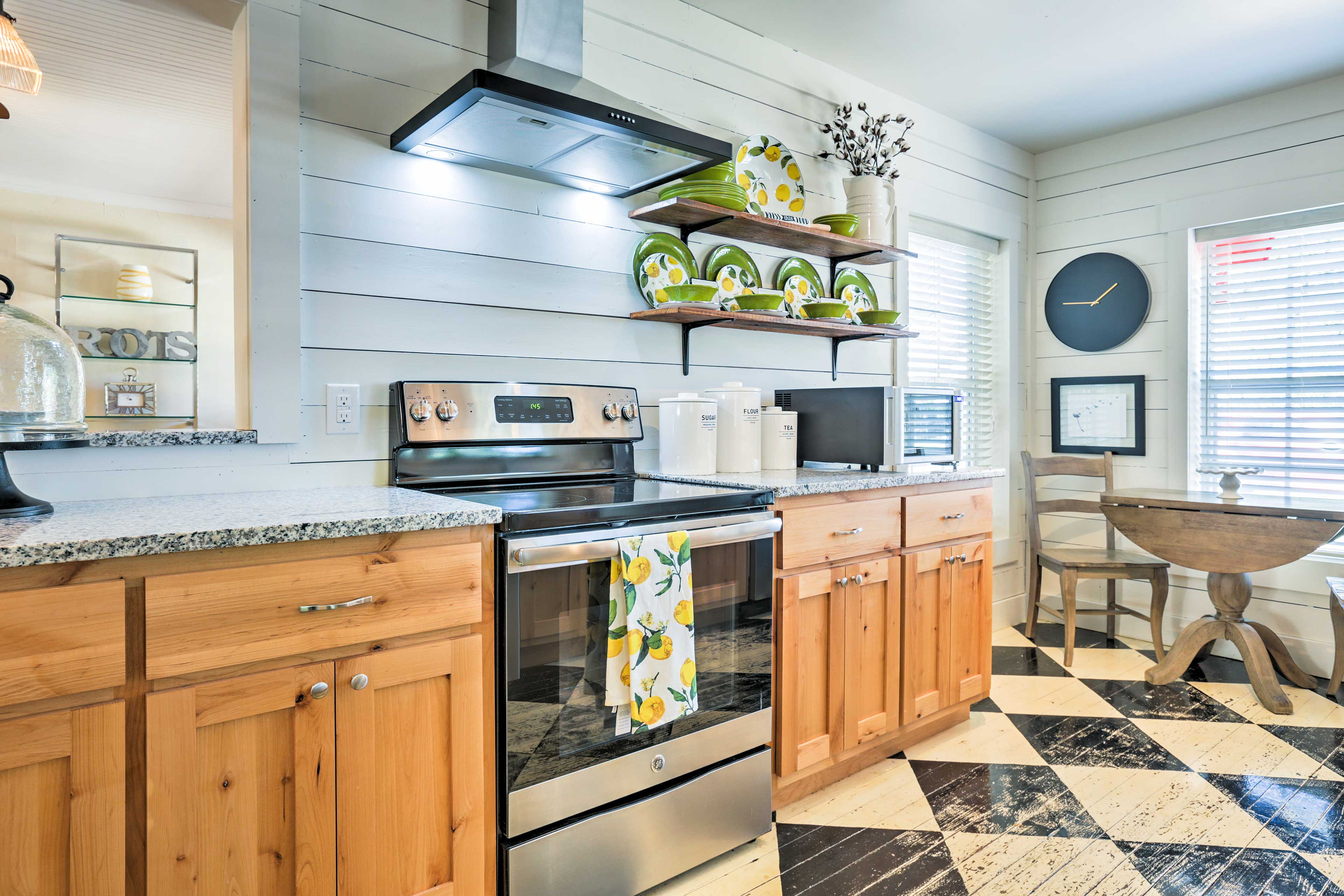 Unique flooring catches your eye as you enter the fully equipped kitchen with stainless steel appliances and a small breakfast table with seating for 2.