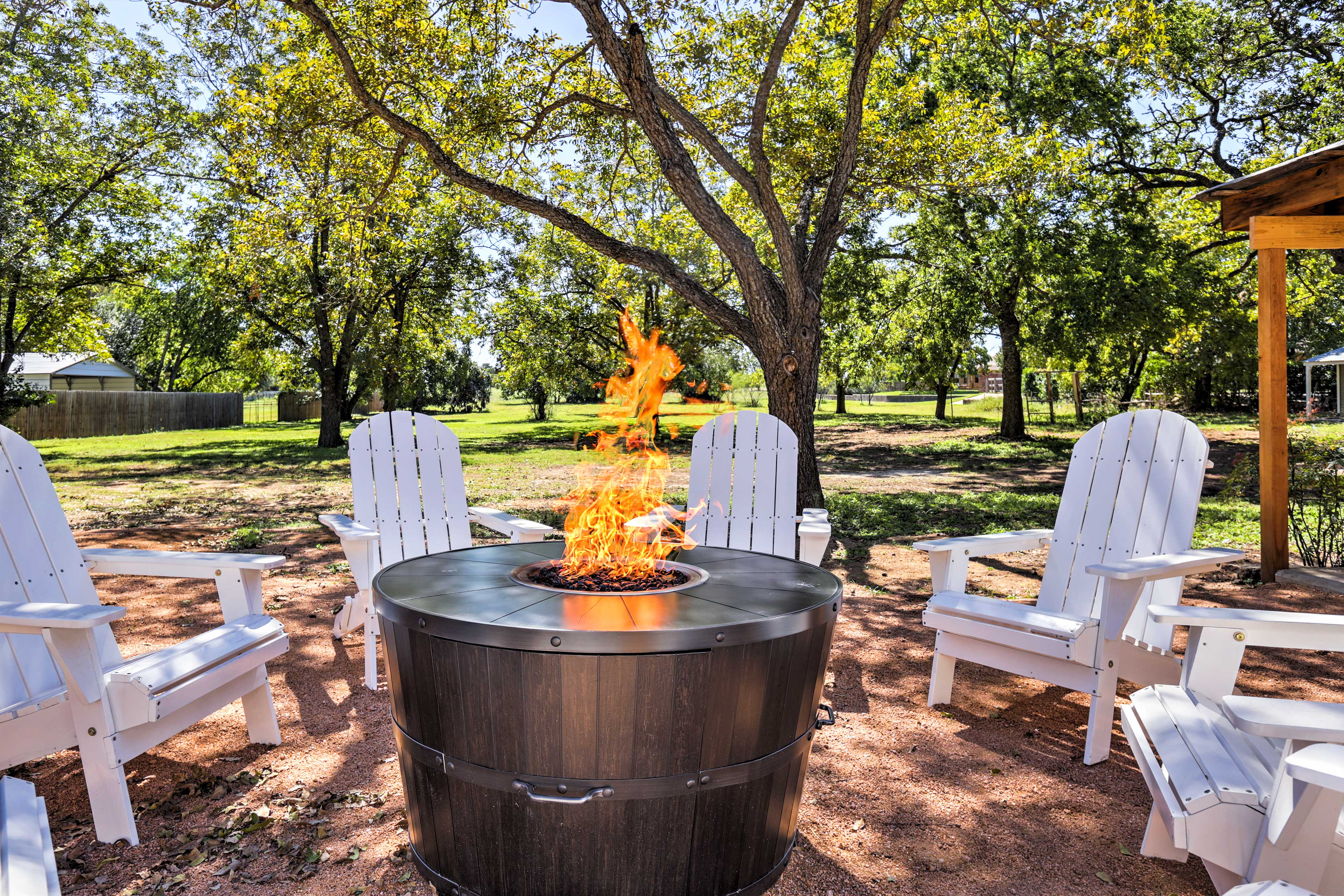Keep warm on cool nights around the gas fire pit with 8 Adirondack chairs.
