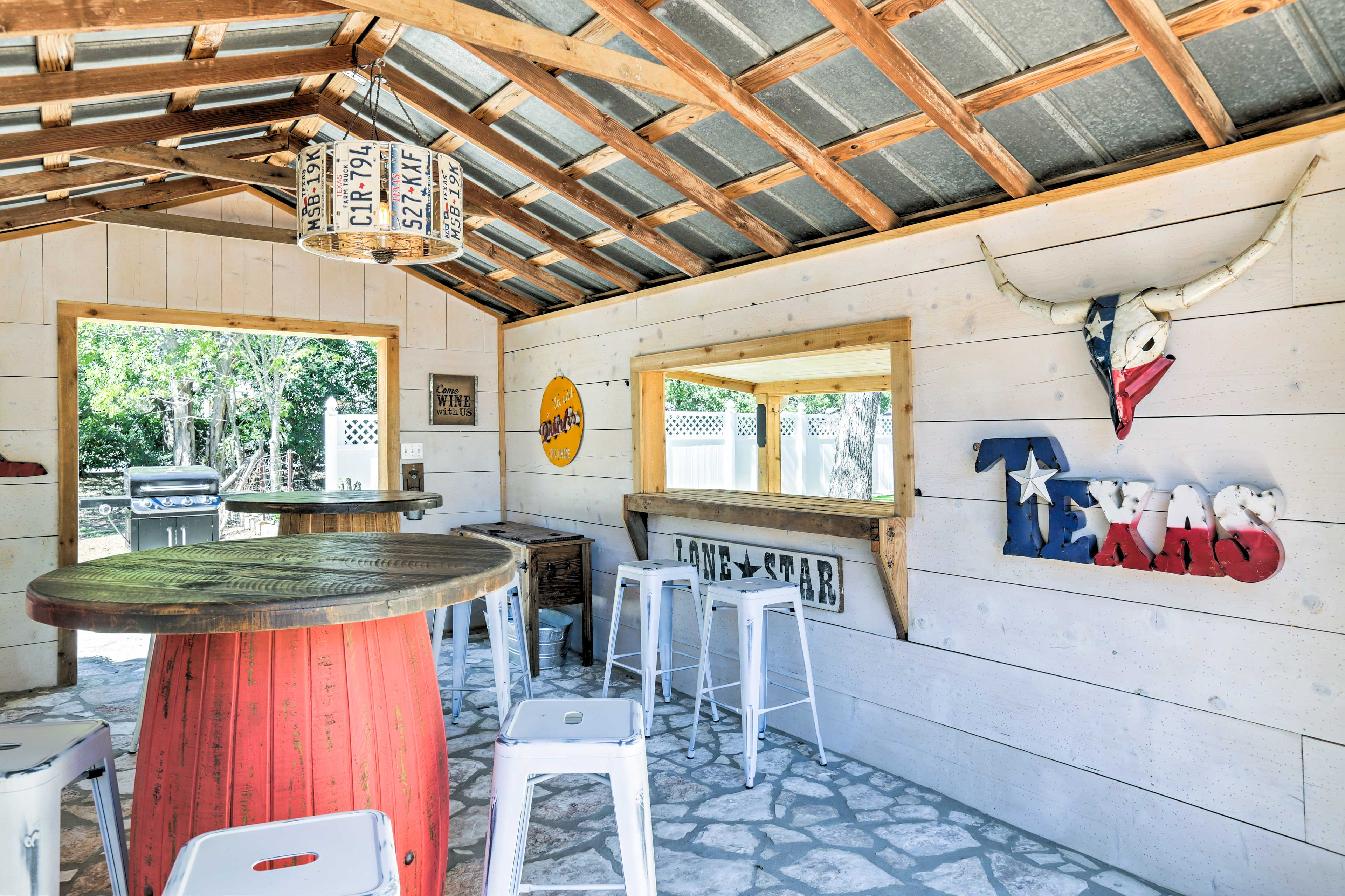 The barn features 2 bar tables and seating for 8.