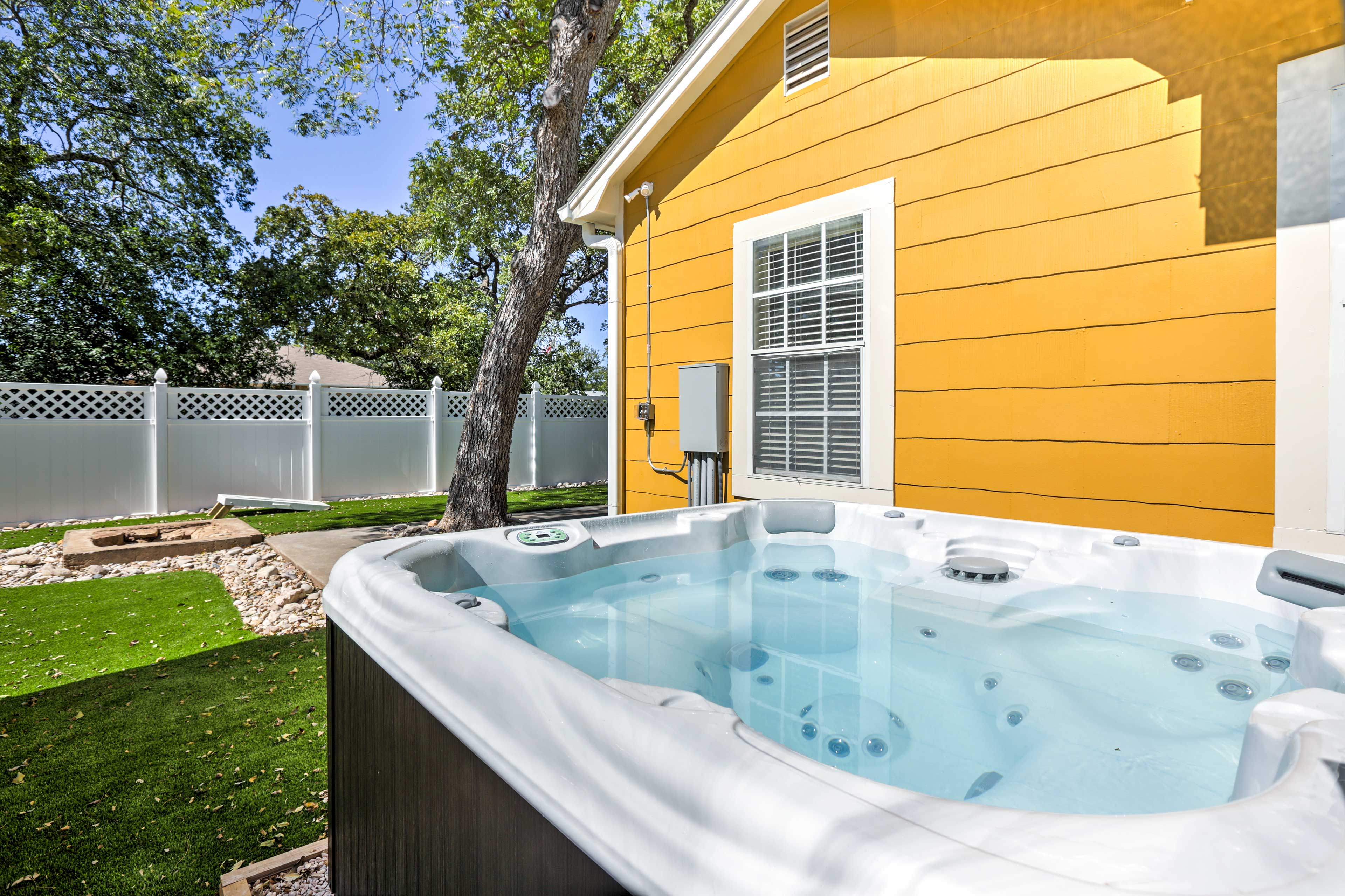 Slip into the private hot tub for a relaxing soak.