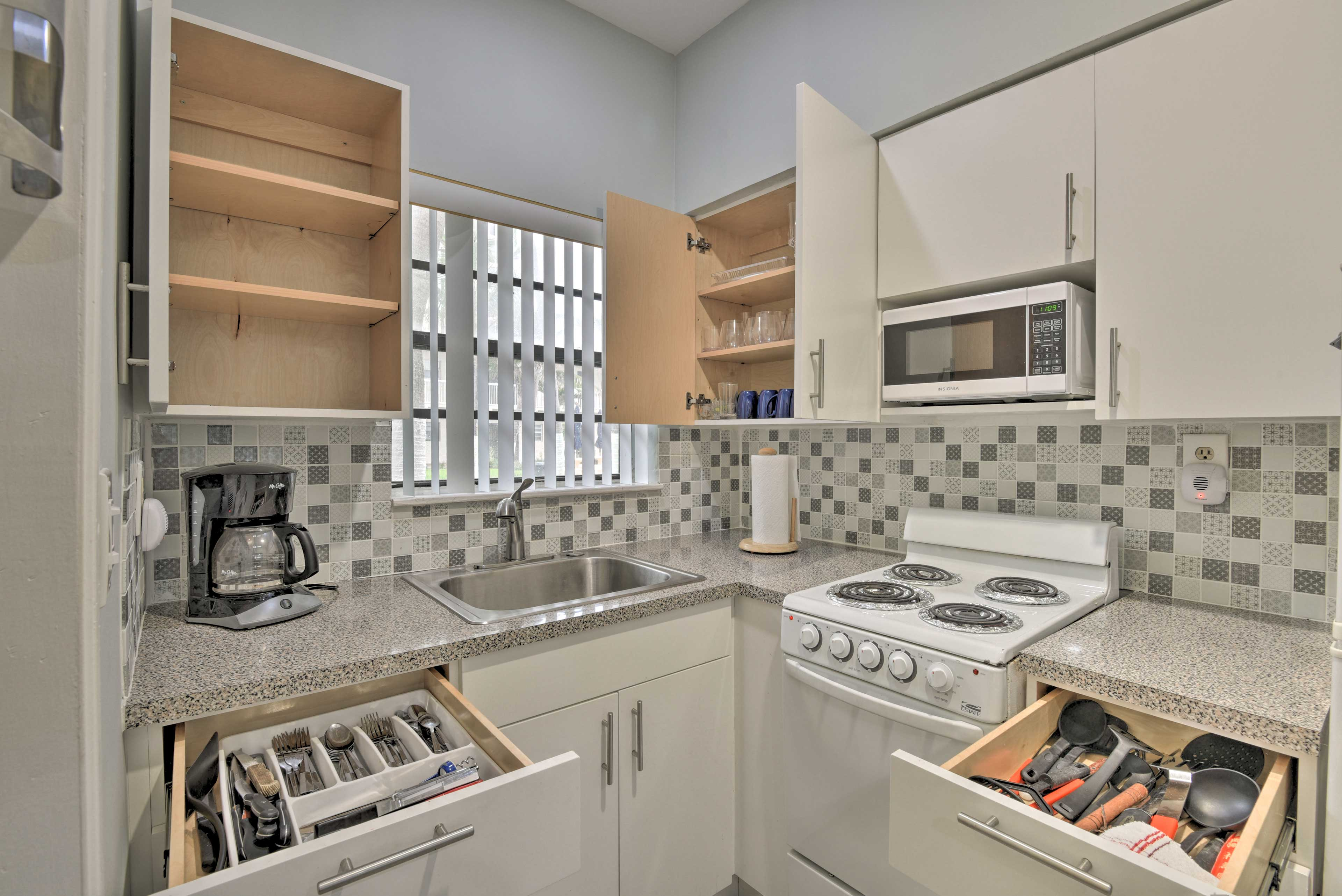 Cooking utensils, silverware, and flatware are all provided in the kitchen!
