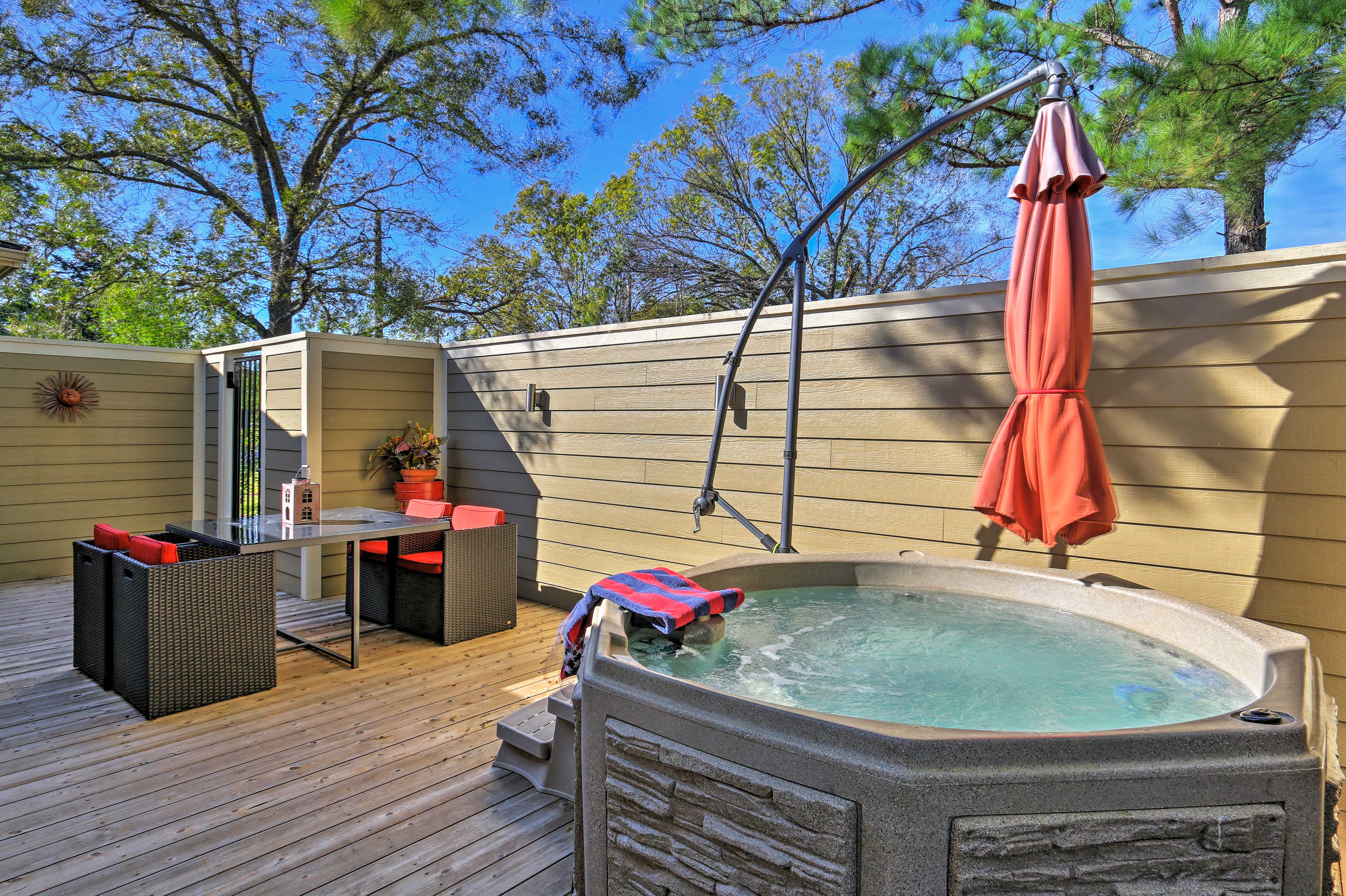 Unwind with a glass of wine in the spa-like Jacuzzi with serene surroundings.